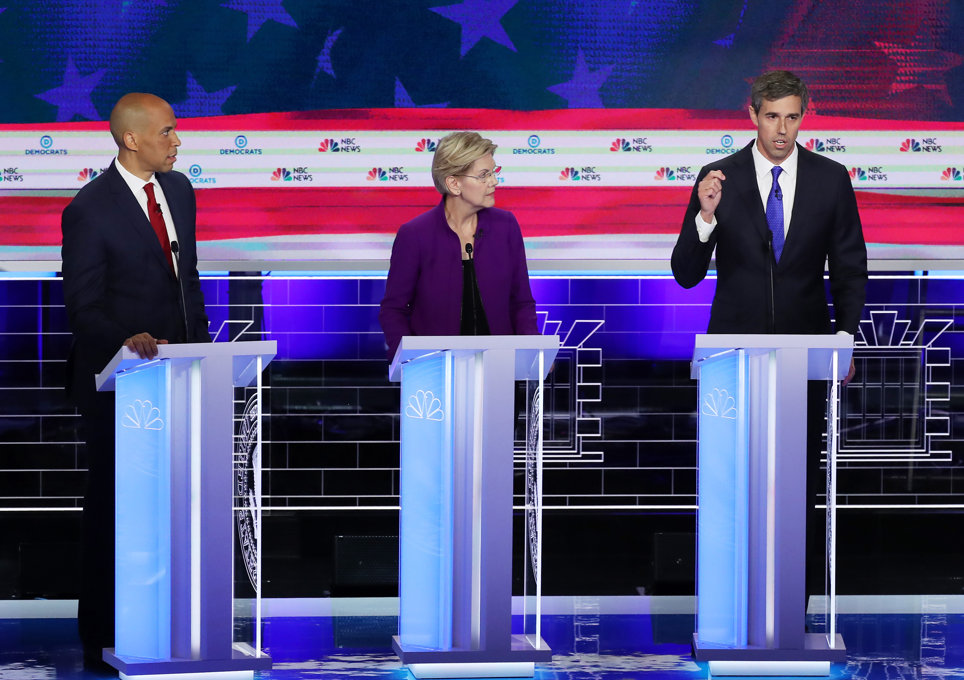 MIAMI, FLORIDA - JUNE 26: Former Texas congressman Beto O'Rourke (R) speaks as Sen. Cory Booker (D-NJ) and Sen. Elizabeth Warren (D-MA) look on during the first night of the Democratic presidential debate on June 26, 2019 in Miami, Florida. (Photo by Joe Raedle/Getty Images)