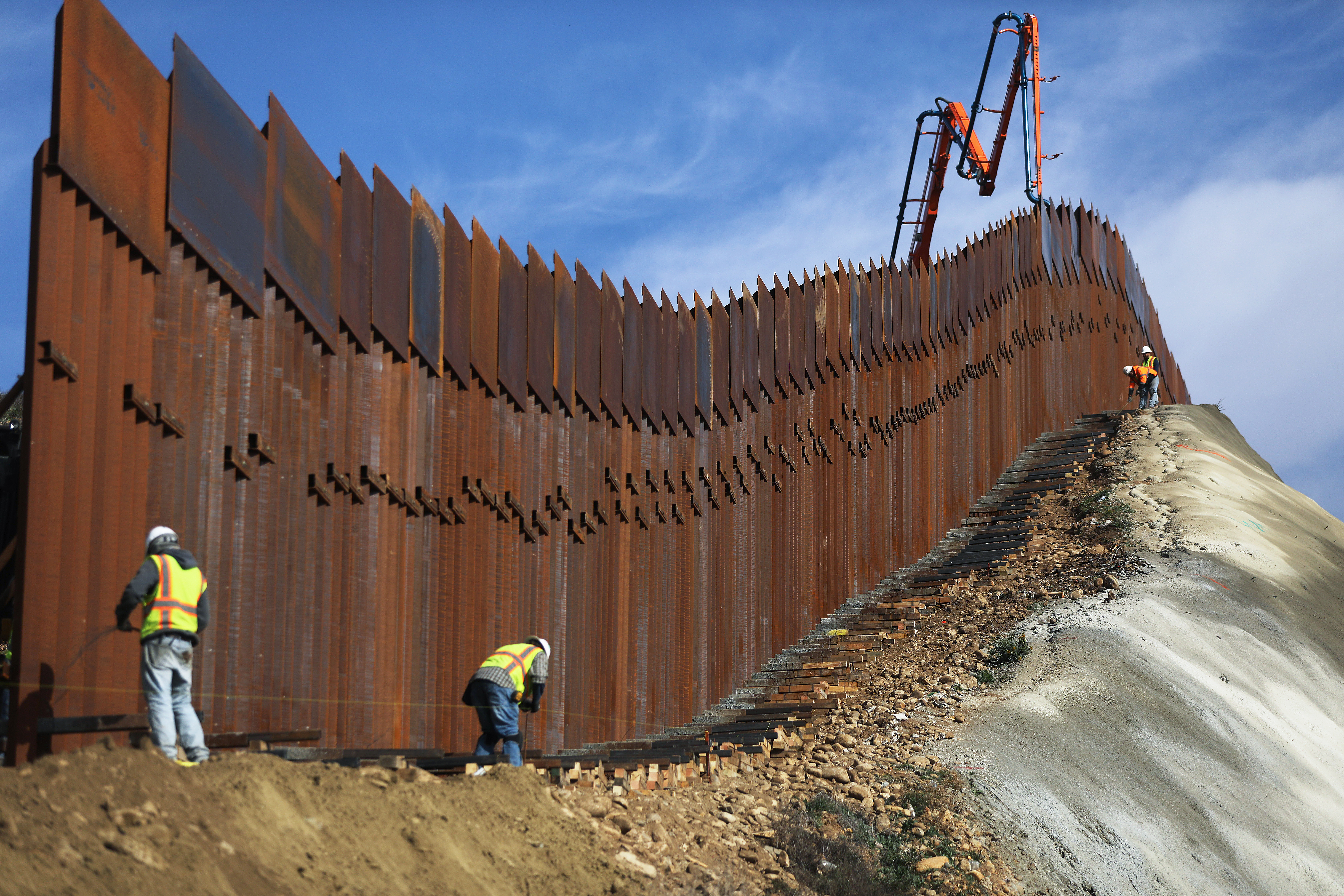 A construction crew works as new sections of the U.S.-Mexico border barrier are installed on January 11, 2019. (Mario Tama/Getty Images)