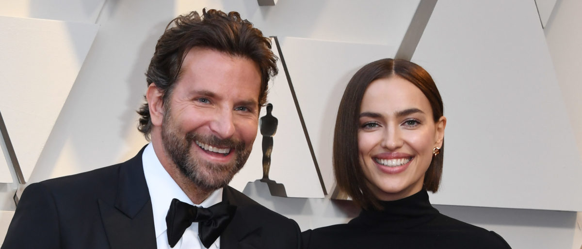 """Best Actor nominee for """"A Star is Born"""" Bradley Cooper (L) and his wife Russian model Irina Shayk arrive for the 91st Annual Academy Awards at the Dolby Theatre in Hollywood, California on February 24, 2019. (Photo credit MARK RALSTON/AFP/Getty Images)"""
