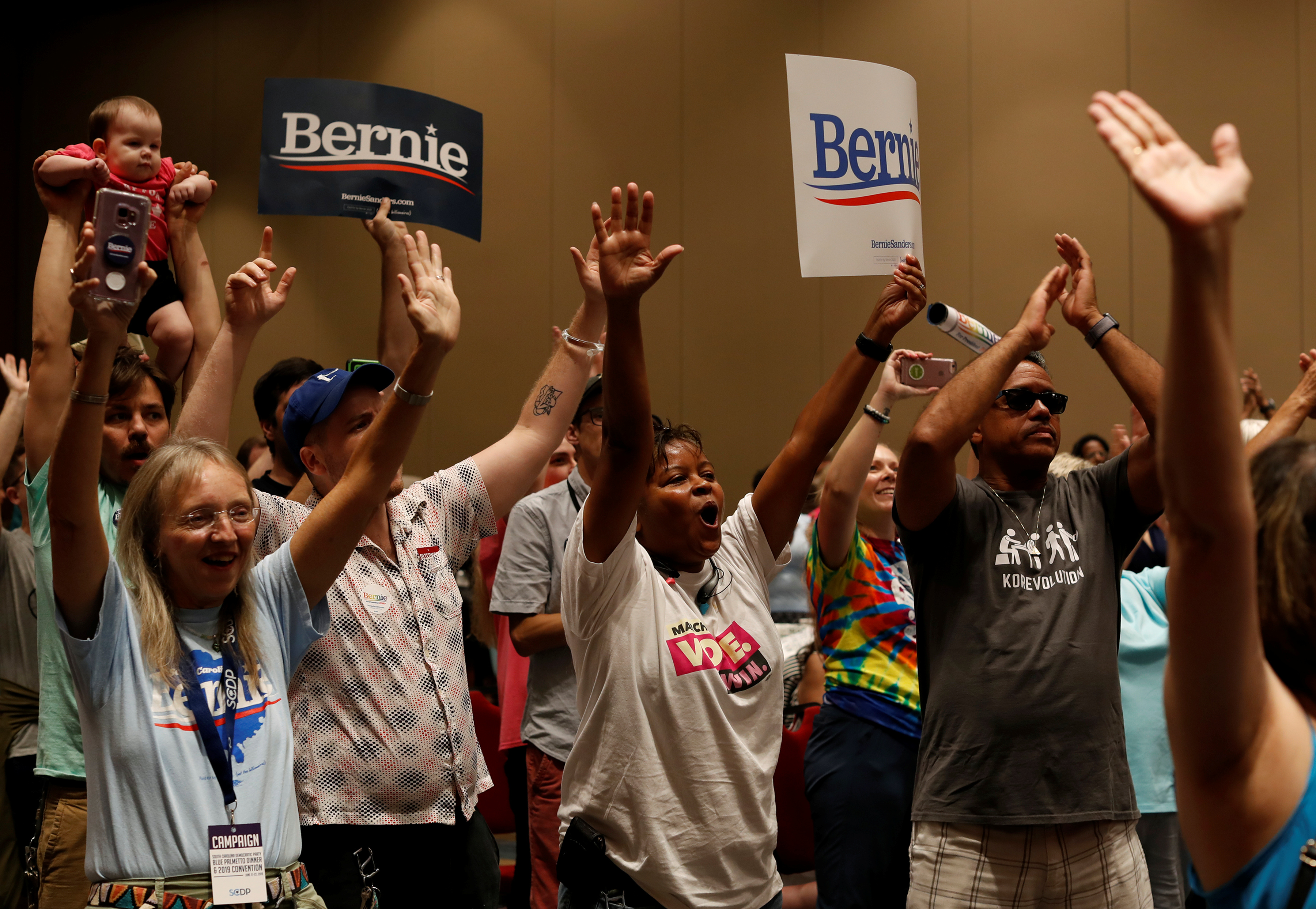 Supporters of Democratic presidential candidate Bernie Sanders hold their hands in the air during a rally for the candidate at the SC Democratic Convention in Columbia, South Carolina, U.S., June 22, 2019. REUTERS/Randall Hill