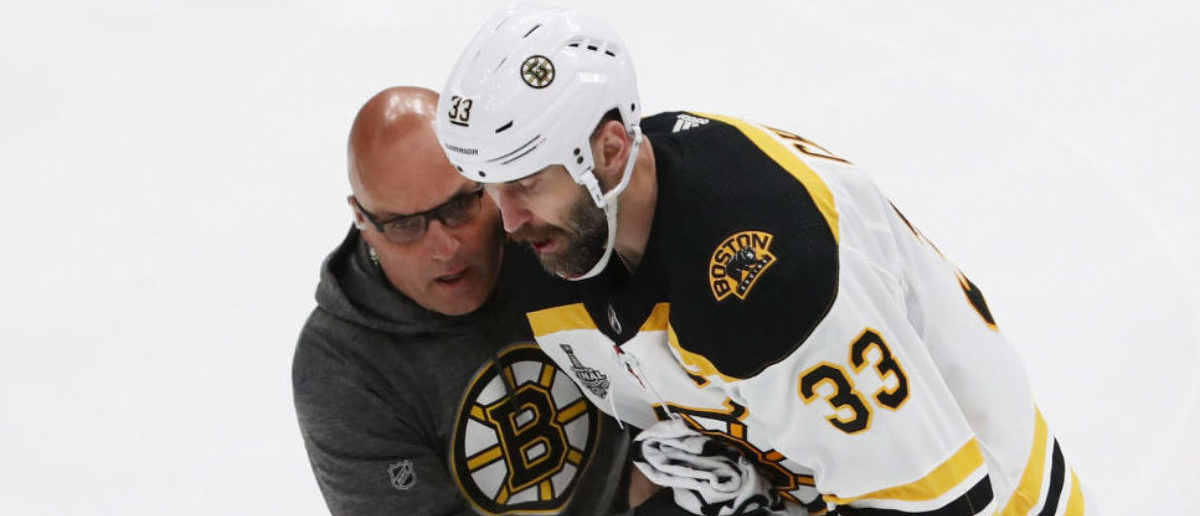 ST LOUIS, MISSOURI - JUNE 03: Zdeno Chara #33 of the Boston Bruins is attended to after being injured during the game against the St. Louis Blues in Game Four of the 2019 NHL Stanley Cup Final at Enterprise Center on June 03, 2019 in St Louis, Missouri. (Photo by Jamie Squire/Getty Images)