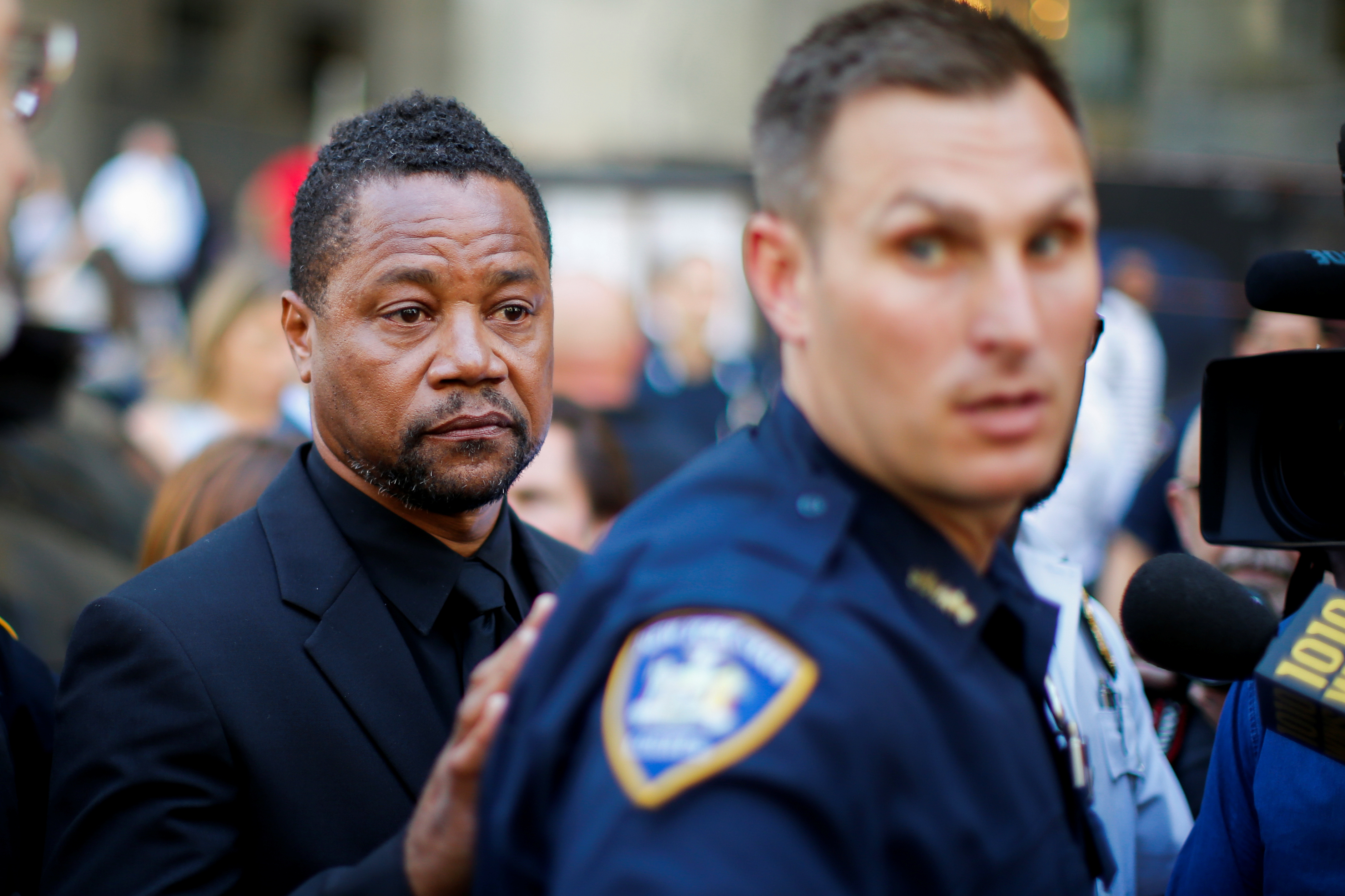 Actor Cuba Gooding Jr. is surrounded by media as he leaves New York Criminal Court in the Manhattan borough of New York City, U.S., June 26, 2019. REUTERS/Eduardo Munoz - RC112C4D60B0
