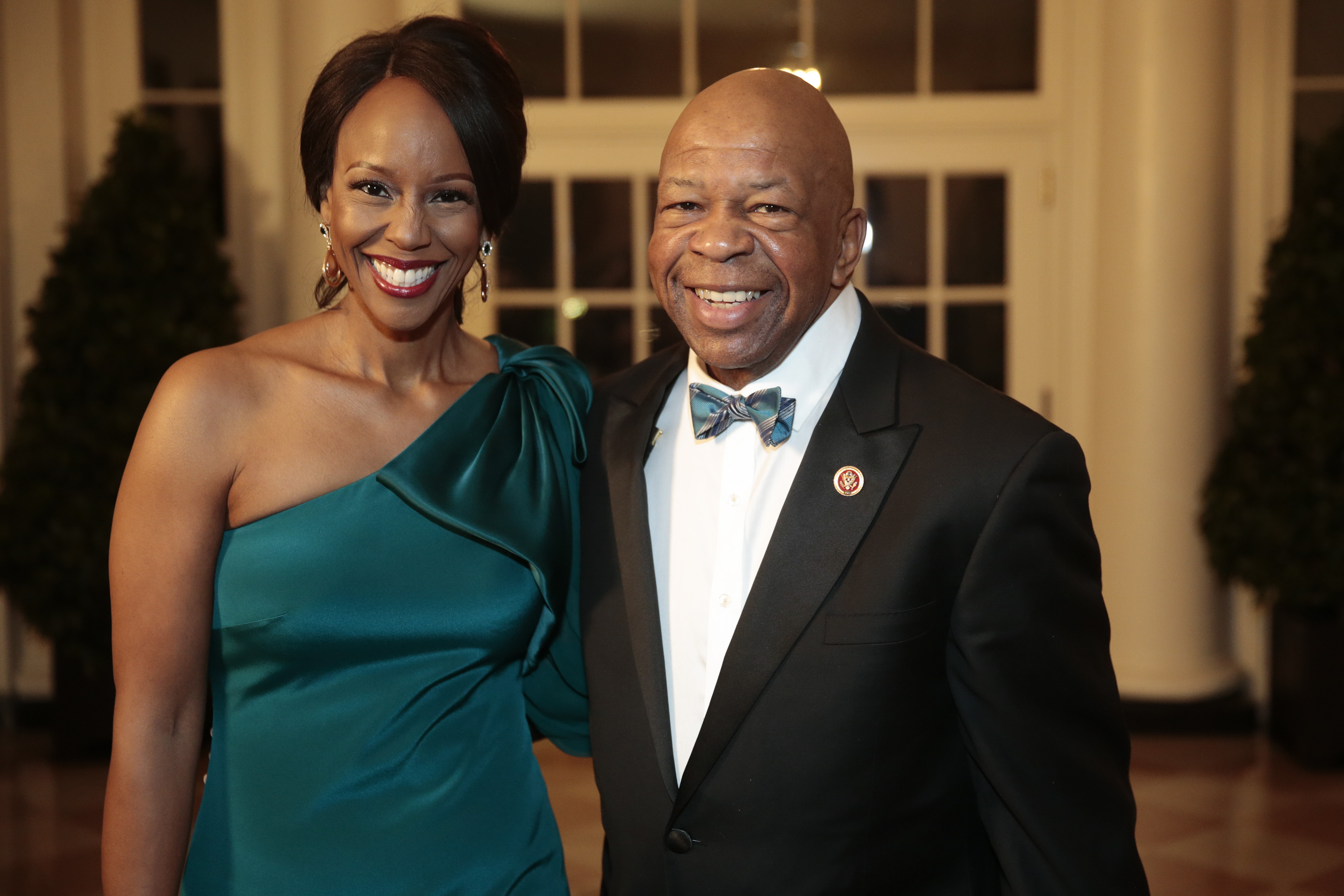 WASHINGTON, DC - FEBRUARY 11: Representative Elijah Cummings, a Democrat from Maryland, right, and Maya Rockeymoore Cummings arrive to a state dinner hosted by U.S. President Barack Obama and U.S. first lady Michelle Obama in honor of French President Francois Hollande at the White House on February 11, 2014 in Washington, DC. (Photo by Andrew Harrer-Pool/Getty Images)