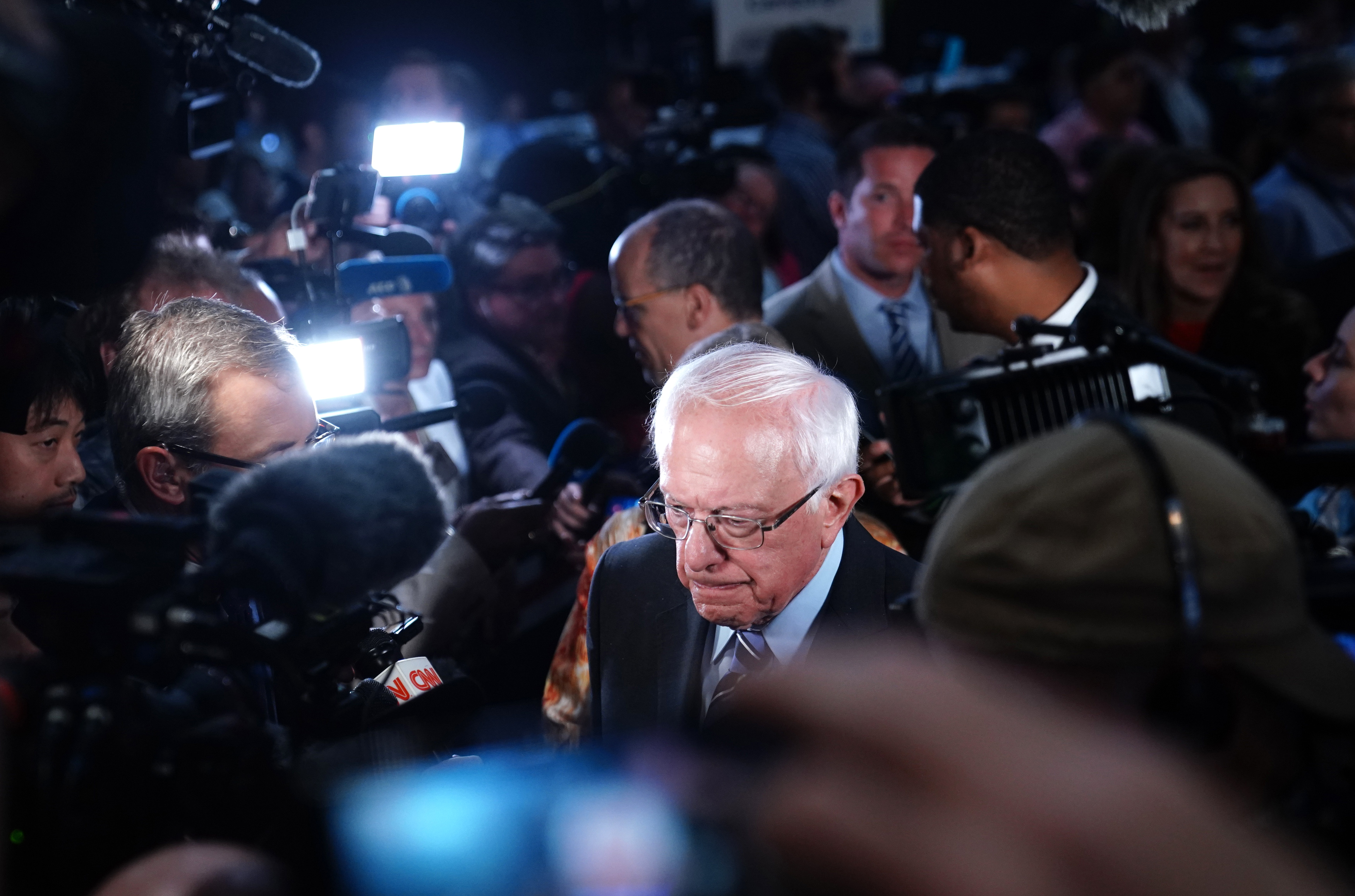 "Senator Bernie Sanders is surrounded by reporters and cameras in the ""spin room"" after the conclusion of the second night of the first U.S. 2020 presidential election Democratic candidates debate in Miami, Florida, U.S., June 27, 2019. REUTERS/Carlo Allegri"