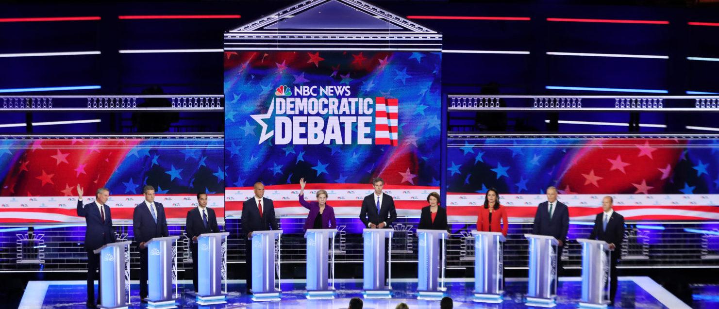 MIAMI, FLORIDA - JUNE 26: Democratic presidential candidates New York City Mayor Bill De Blasio (L-R), Rep. Tim Ryan (D-OH), former housing secretary Julian Castro, Sen. Cory Booker (D-NJ), Sen. Elizabeth Warren (D-MA), former Texas congressman Beto O'Rourke, Sen. Amy Klobuchar (D-MN), Rep. Tulsi Gabbard (D-HI), Washington Gov. Jay Inslee, and former Maryland congressman John Delaney take part in the first night of the Democratic presidential debate on June 26, 2019 in Miami, Florida. (Photo by Joe Raedle/Getty Images)