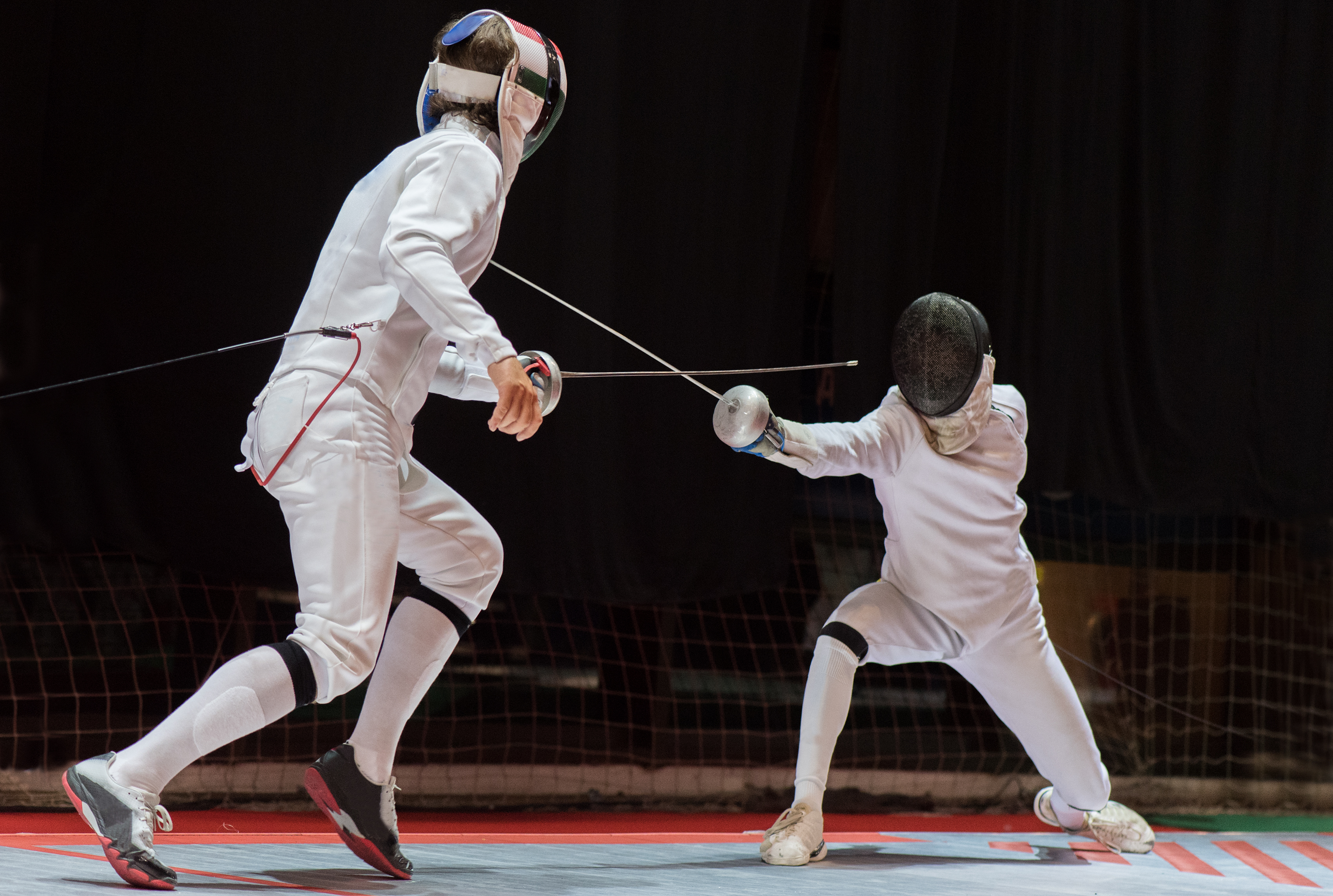 Pictured are people fencing. SHUTTERSTOCK/ Fotokostic