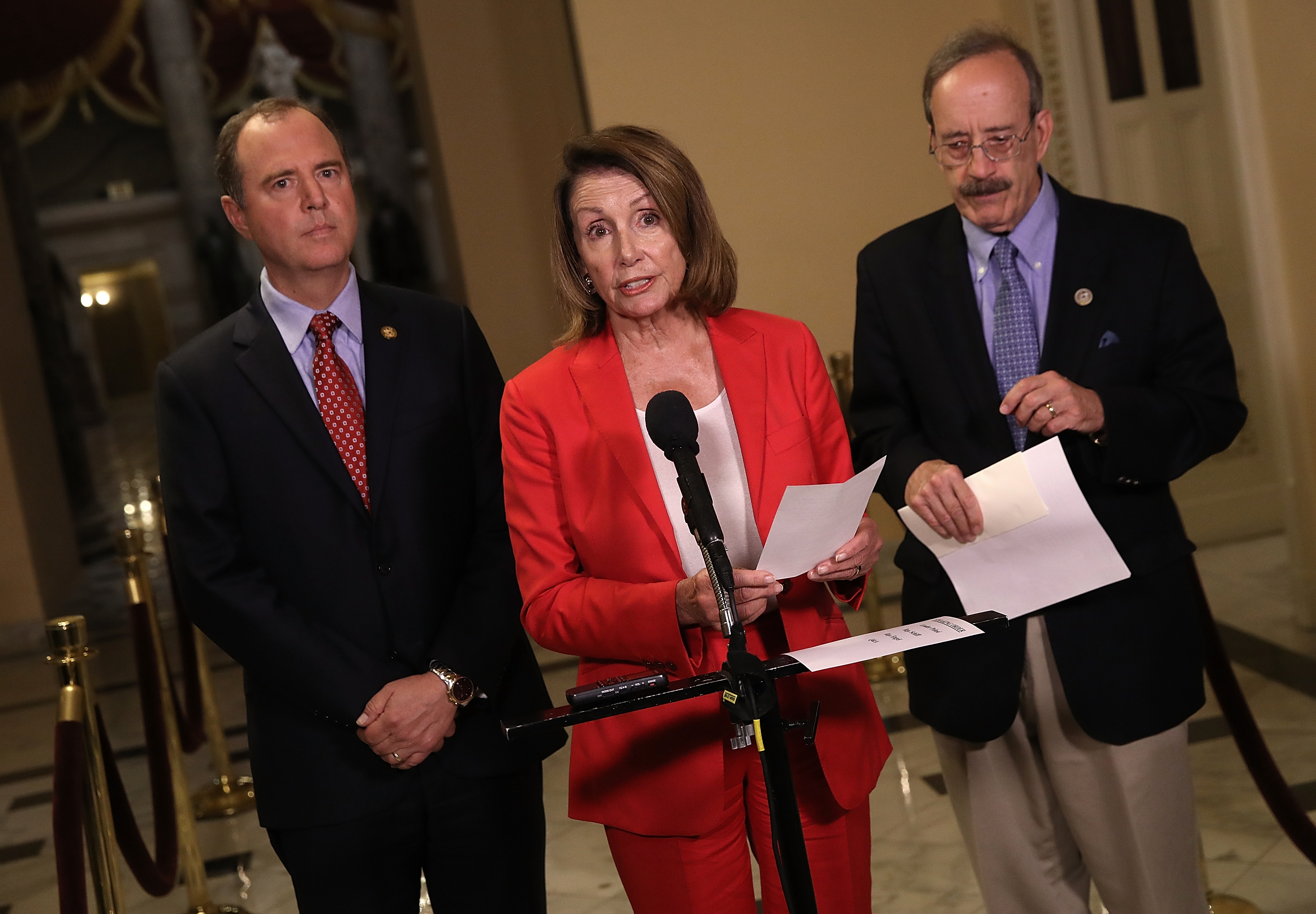 House Minority Leader Nancy Pelosi speaks at a press conference at the U.S. Capitol July 23, 2018 in Washington, DC. Pelosi, Rep. Adam Schiff (L) and Rep. Eliot Engel (R) have introduced a resolution condemning U.S. President Donald Trump's statements during the recent summit with Russian President Vladimir Putin in Helsinki. (Photo by Win McNamee/Getty Images)