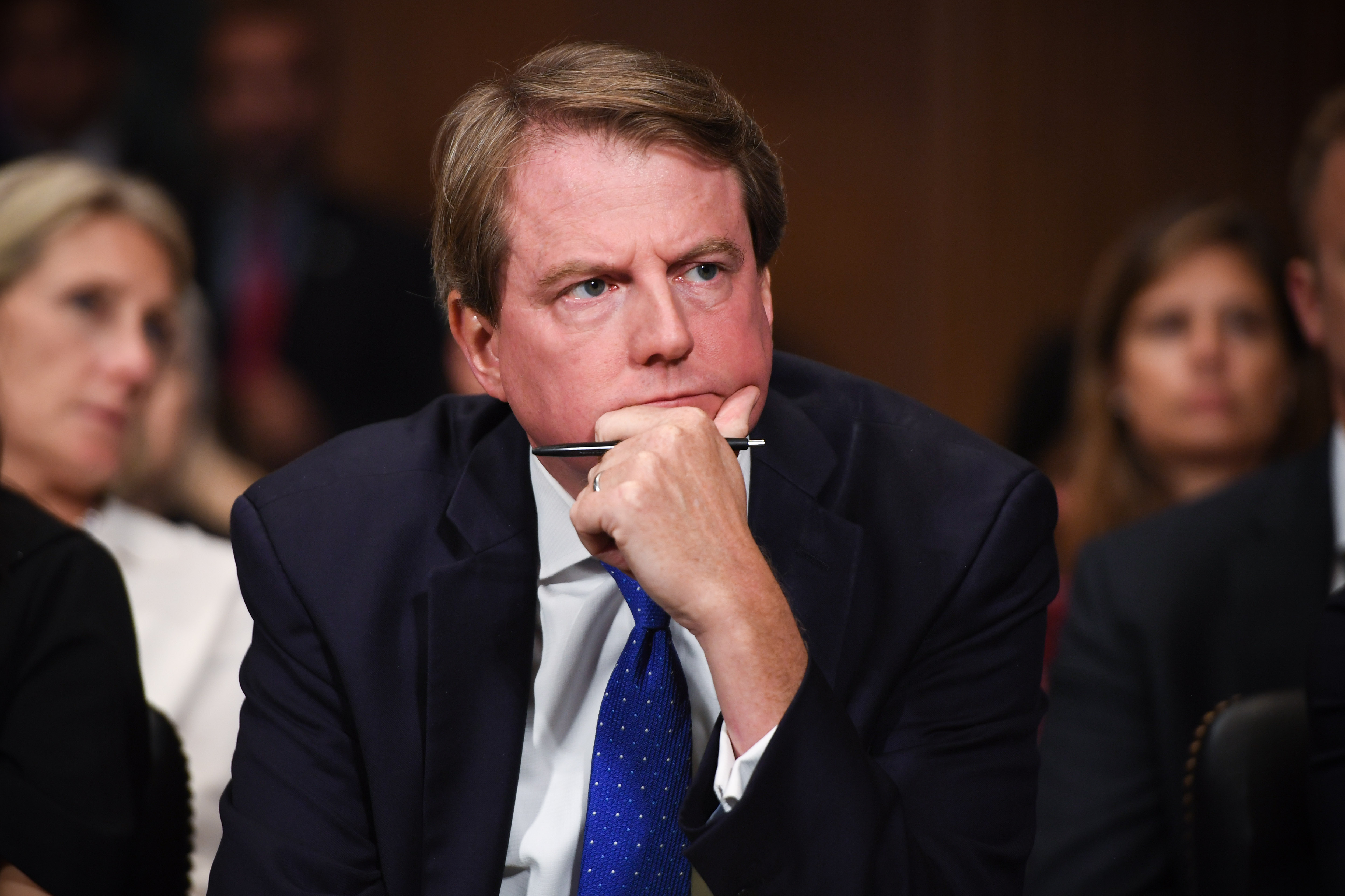 White House Counsel and Assistant to the President for U.S. President Donald Trump, Donald McGahn, listens as Supreme Court nominee Brett Kavanaugh testifies before the Senate Judiciary Committee on Capitol Hill on September 27, 2018. (Saul Loeb - Pool/Getty Images)