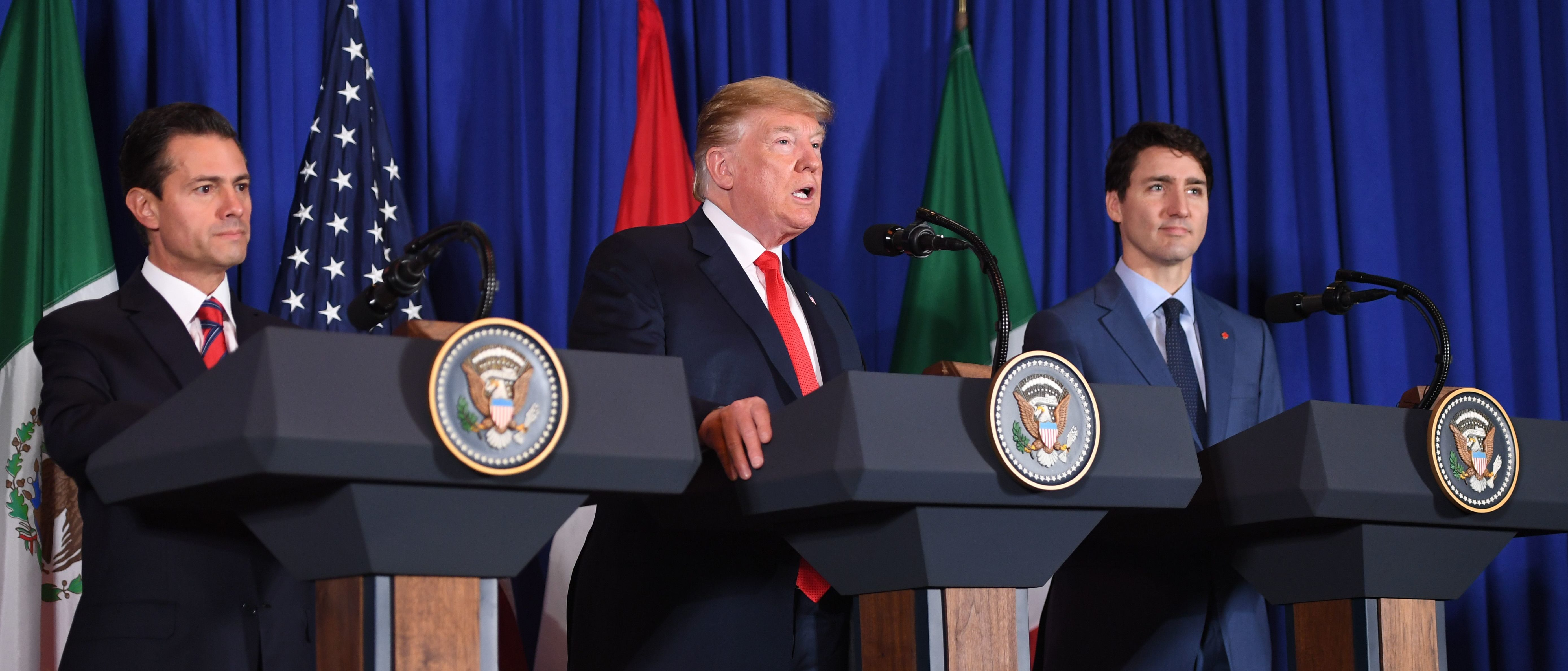 (L to R) Mexican President Enrique Pena Nieto, US President Donald Trump and Canadian Prime Minister Justin Trudeau deliver a statement on the signing of a new free trade agreement in Buenos Aires, on November 30, 2018 (SAUL LOEB / AFP) (Photo credit should read SAUL LOEB/AFP/Getty Images)