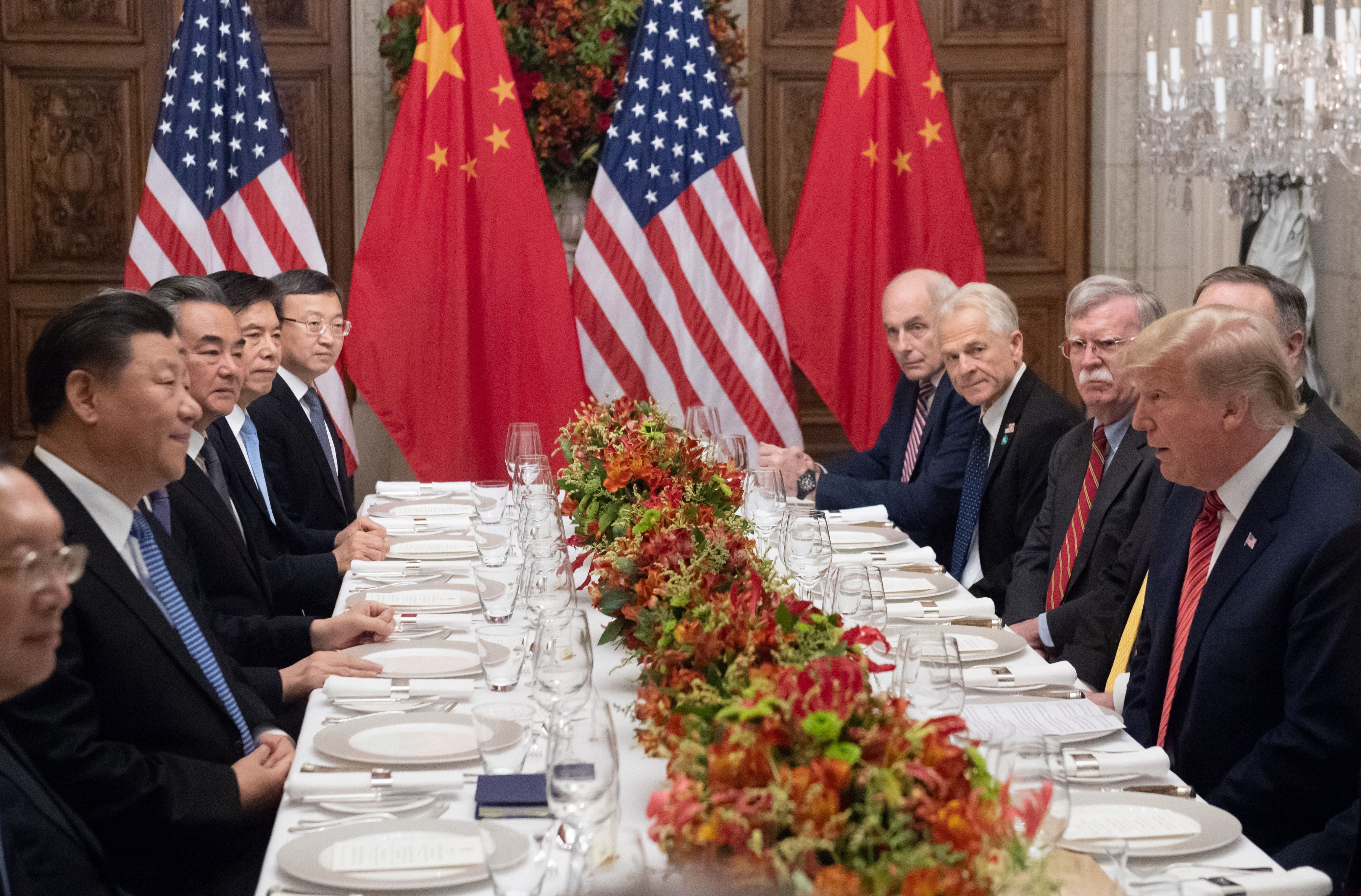 Donald Trump (R) and China's President Xi Jinping (L) along with members of their delegations, hold a dinner meeting at the end of the G20 Leaders' Summit in Buenos Aires, on December 01, 2018. - US President Donald Trump and his Chinese counterpart Xi Jinping had the future of their trade dispute -- and broader rivalry between the world's two top economies. (SAUL LOEB/AFP/Getty Images)