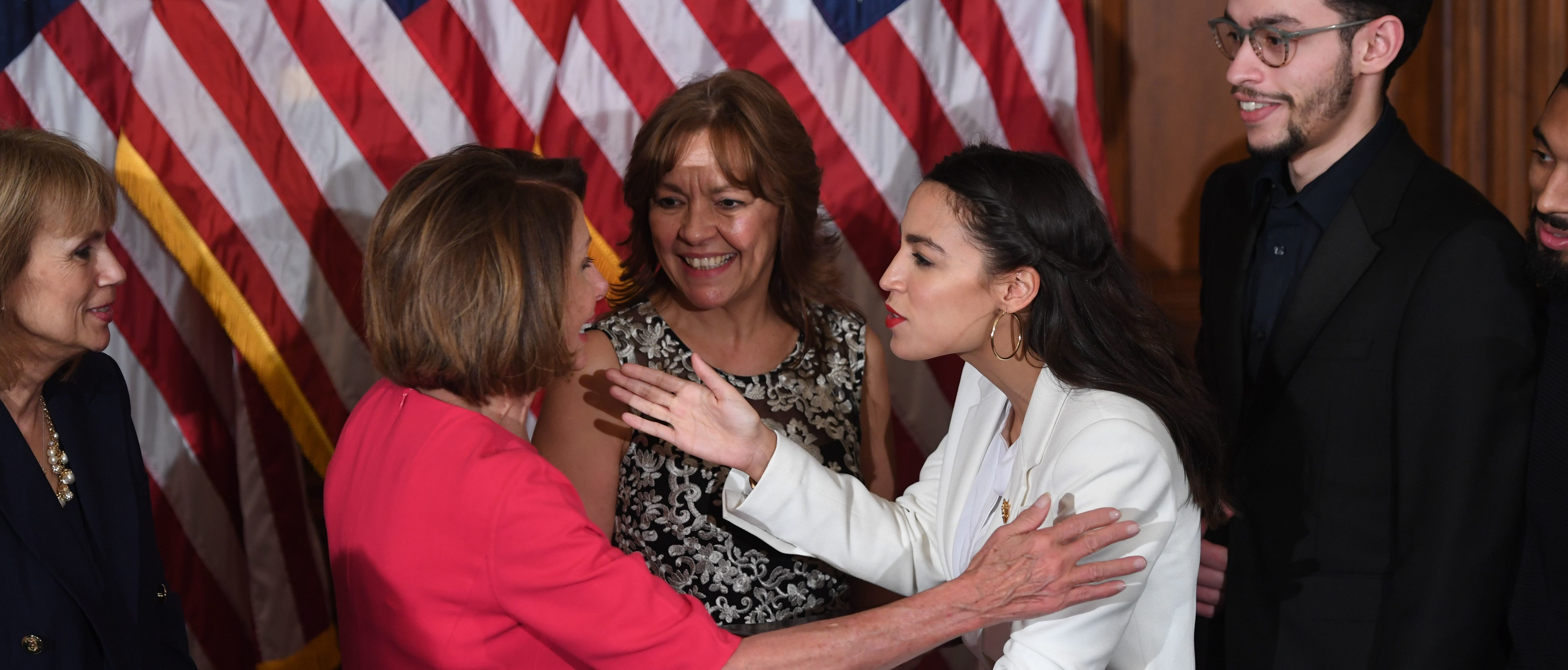 Speaker of the House Nancy Pelosi (L) greets Rep. Alexandria Ocasio-Cortez (R), D-NY, during the ceremonial swearing-in at the start of the 116th Congress at the US Capitol in Washington, DC, January 3, 2019. (Photo by SAUL LOEB / AFP / GETTY)