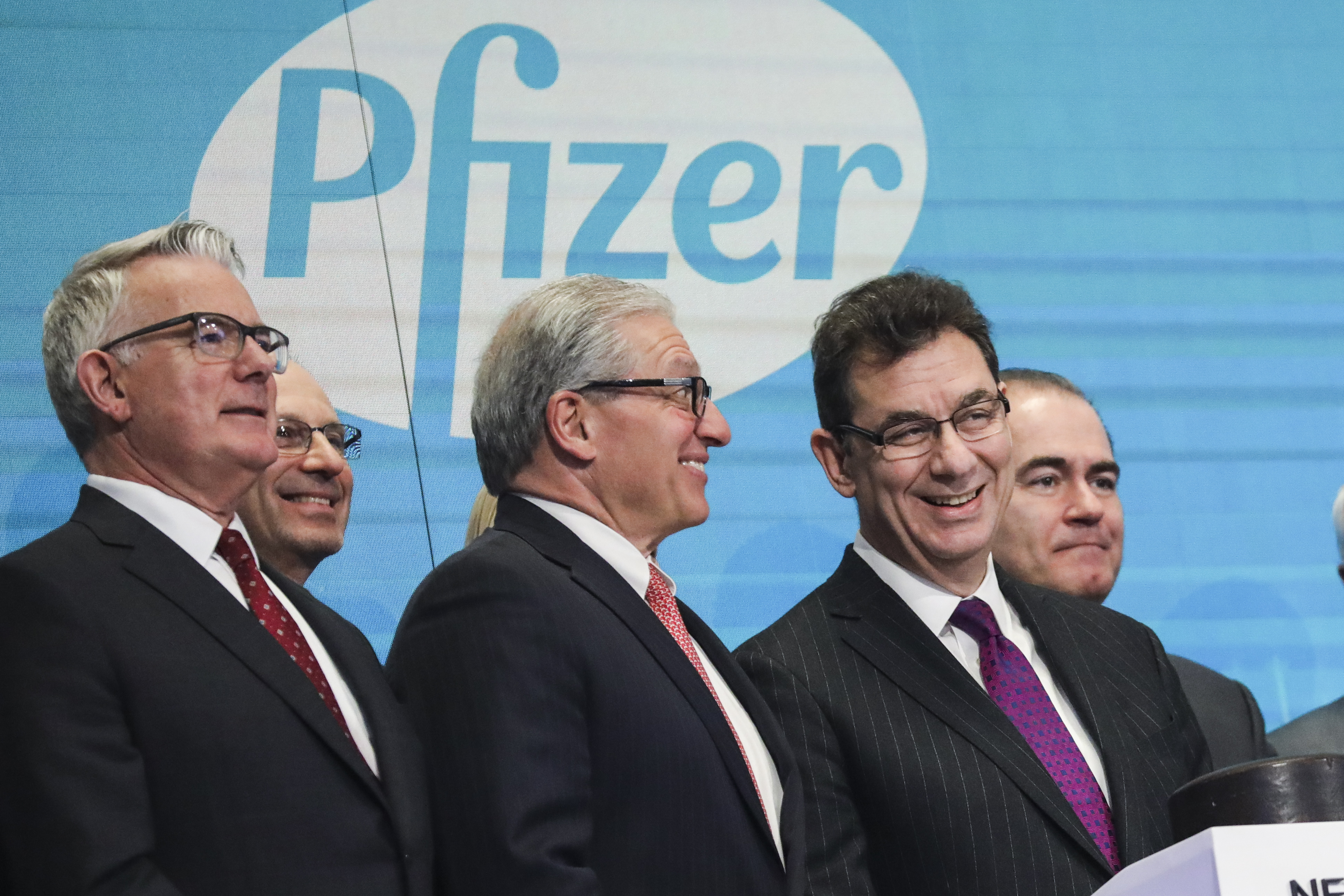 Albert Bourla (R), chief executive officer of Pfizer pharmaceutical company, waits to ring the closing bell at the New York Stock Exchange (NYSE) on Thursday afternoon, January 17, 2019 in New York City. (Photo by Drew Angerer/Getty Images)