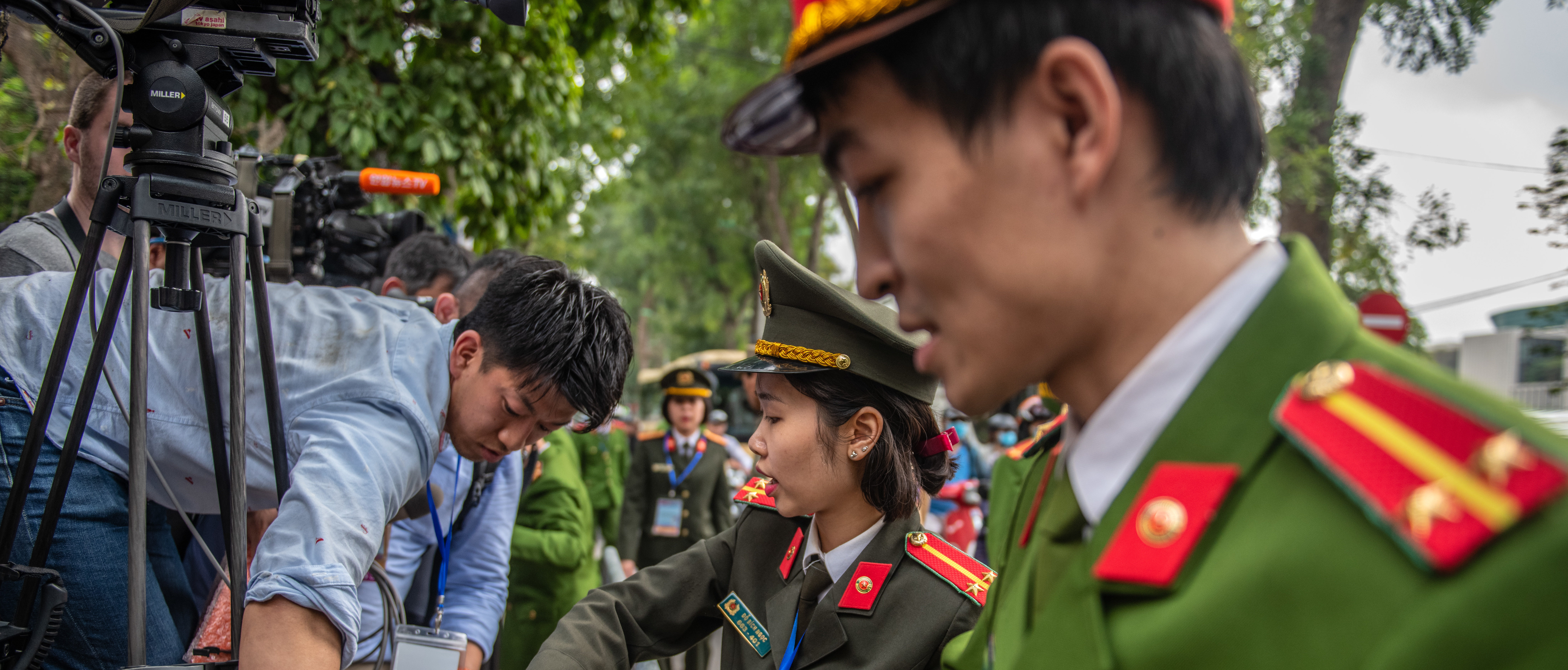 HANOI, VIETNAM - MARCH 01: Police officers move members of the media ahead of the arrival of North Korean leader Kim Jong-un at the Presidential Palace on March 1, 2019 in Hanoi, Vietnam. North Korean leader Kim Jong-un began his two-day official visit to Vietnam on Friday after his second summit with U.S. President Donald Trump in Hanoi which ended without an agreement made. (Photo by Carl Court/Getty Images)
