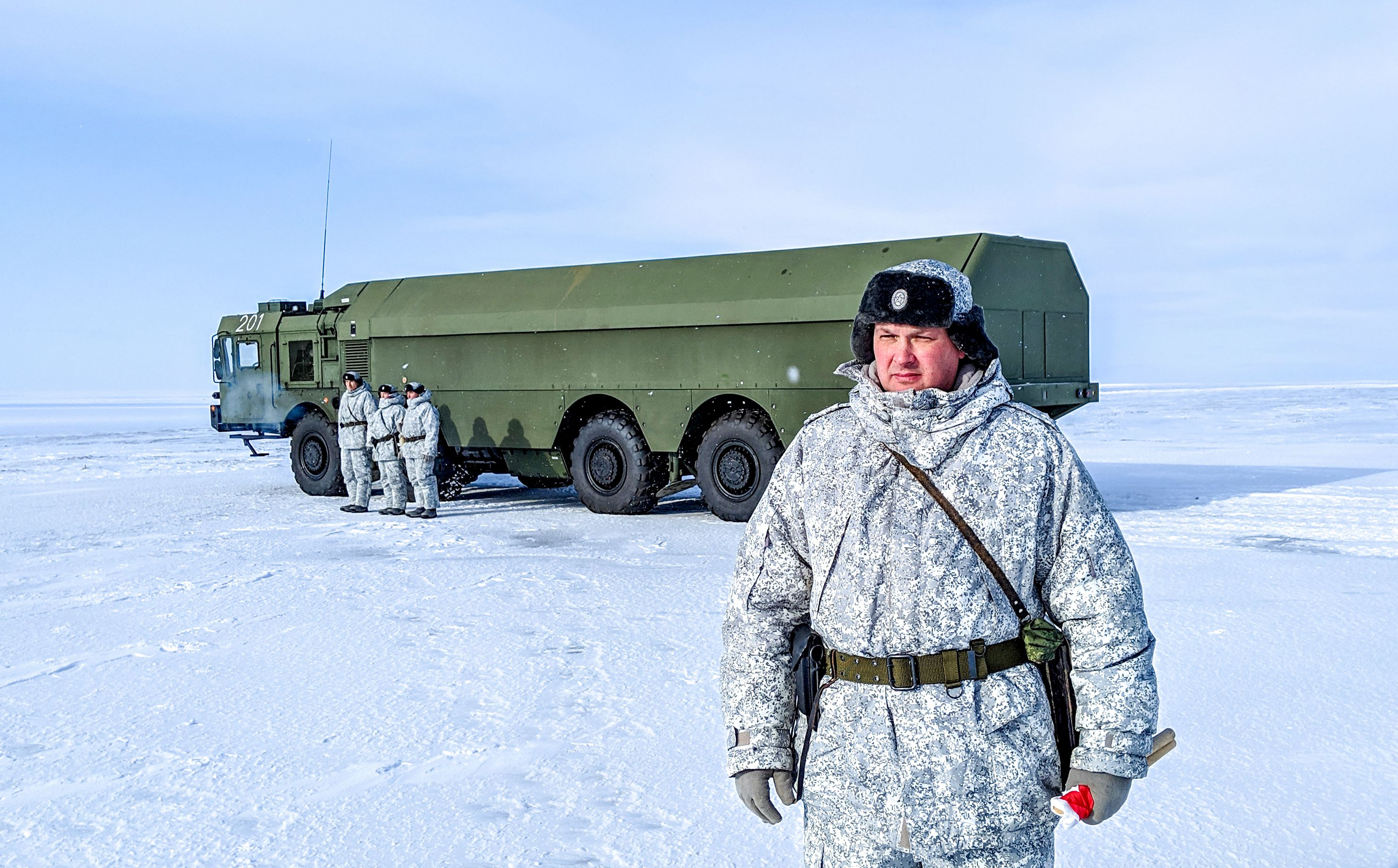 "A Russian officer and soldiers stand next to a special military truck at the Russian northern military base on Kotelny island, beyond the Arctic Circle on April 3, 2019. — The Russian military base dubbed the ""Northern Clover"" is to serve as a model for future military installations in the Arctic, a strategic region for Moscow, which continues to strengthen its presence in the Arctic. (Maxime Popov/AFP/Getty Images)"
