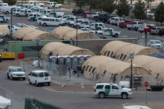"Tents are seen at a temporary holding facility for migrants that has been in use since early May, to hold the record numbers of migrants entering the El Paso border sector, in El Paso, Texas on May 31, 2019. - A US Department of Homeland Security report warned Friday of ""dangerous overcrowding"" in El Paso, Texas facilities for holding just-arrived migrants, with rooms packed with more than five times the number authorized. The report by the DHS inspector general said the health and security of both migrants and US Customs and Border Protection (CBP) officials is under threat by squeezing people into holding rooms designed for a fraction of their numbers. (Photo by PAUL RATJE/AFP/Getty Images)"