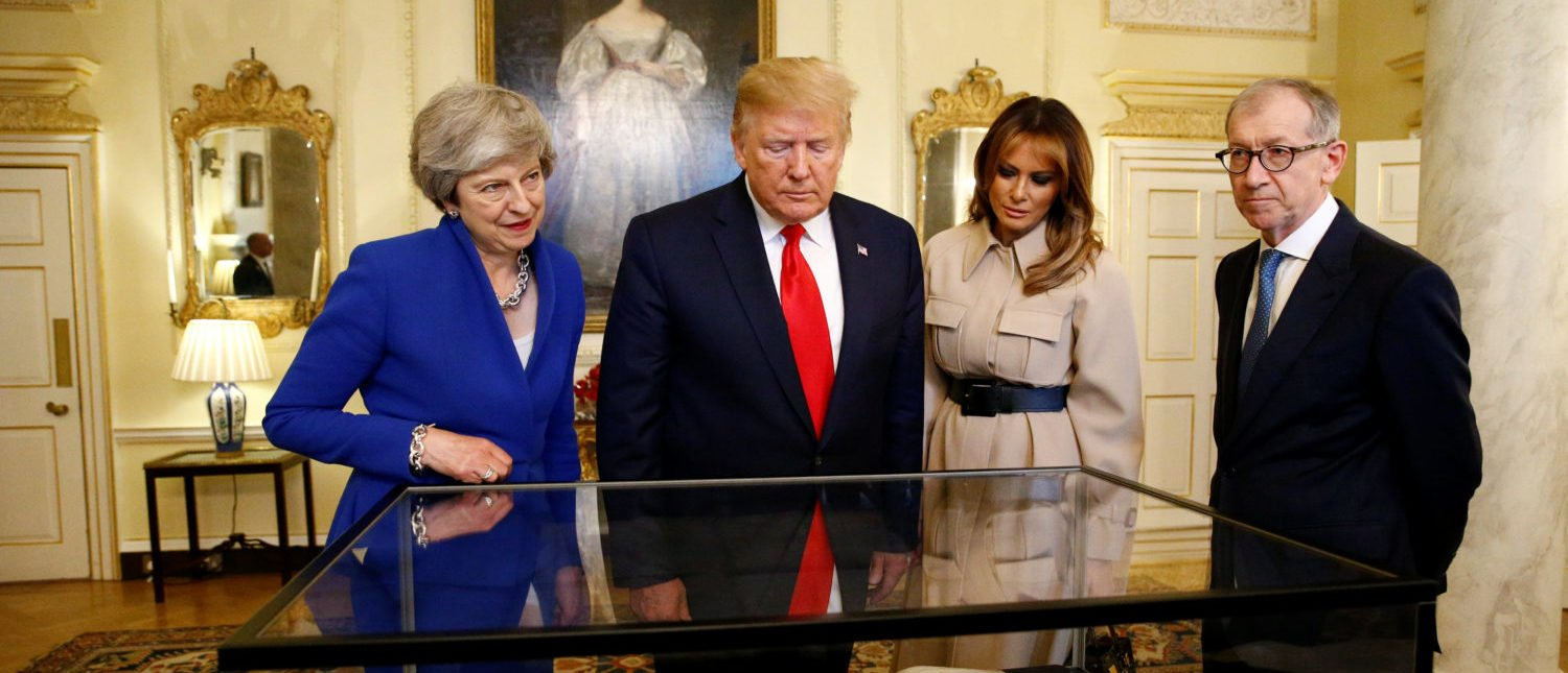 LONDON, ENGLAND - JUNE 04: Prime Minister Theresa May, husband Philip May, US President Donald Trump and First Lady Melania Trump view items during a visit to 10 Downing Street, during the second day of the president's State Visit on June 4, 2019 in London, England. President Trump's three-day state visit began with lunch with the Queen, followed by a State Banquet at Buckingham Palace, whilst today he will attend business meetings with the Prime Minister and the Duke of York, before travelling to Portsmouth to mark the 75th anniversary of the D-Day landings. (Photo by Henry Nicholls - WPA Pool/Getty Images)