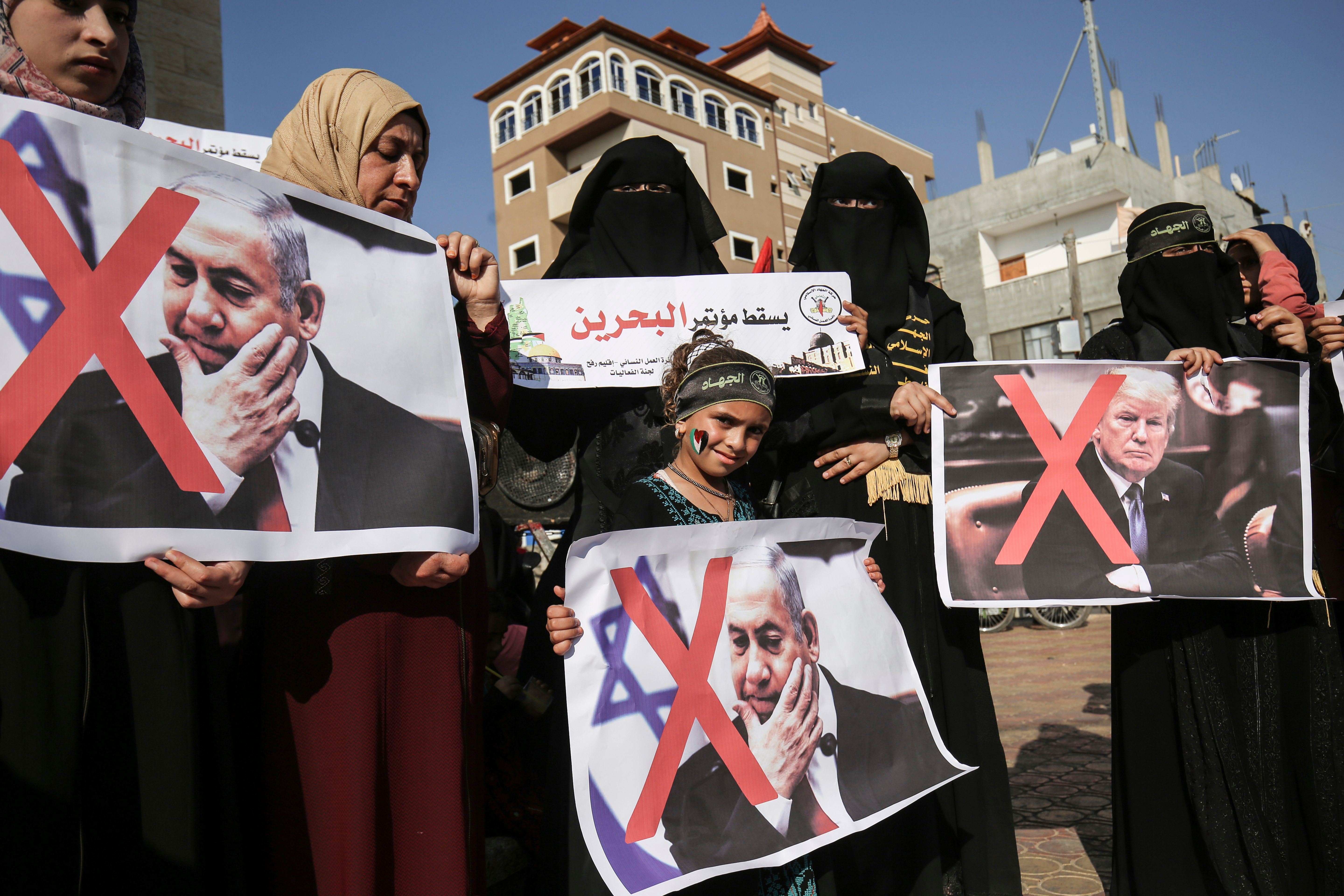 Palestinian female supporters of the Islamic Jihad carry posters of US President Donald Trump and Israeli Prime Minister Benjamin Netanyahu during a protest against the Bahrain economic workshop in the southern Gaza Strip town of Rafah on June 18, 2019. (SAID KHATIB/AFP/Getty Images)