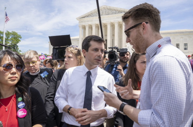 WASHINGTON, DC - MAY 21: Democratic presidential candidate and mayor of South Bend, Indiana Pete Buttigieg speaks to a reporter at a pro-choice rally at the Supreme Court on May 21, 2019 in Washington, DC. The Alabama law, signed by Gov. Kay Ivey last week, includes no exceptions for cases of rape and incest, outlawing all abortions except when necessary to prevent serious health problems for the woman. Though women are exempt from criminal and civil liability, the new law punishes doctors for performing an abortion, making the procedure a Class A felony punishable by up to 99 years in prison. (Photo by Tasos Katopodis/Getty Images)