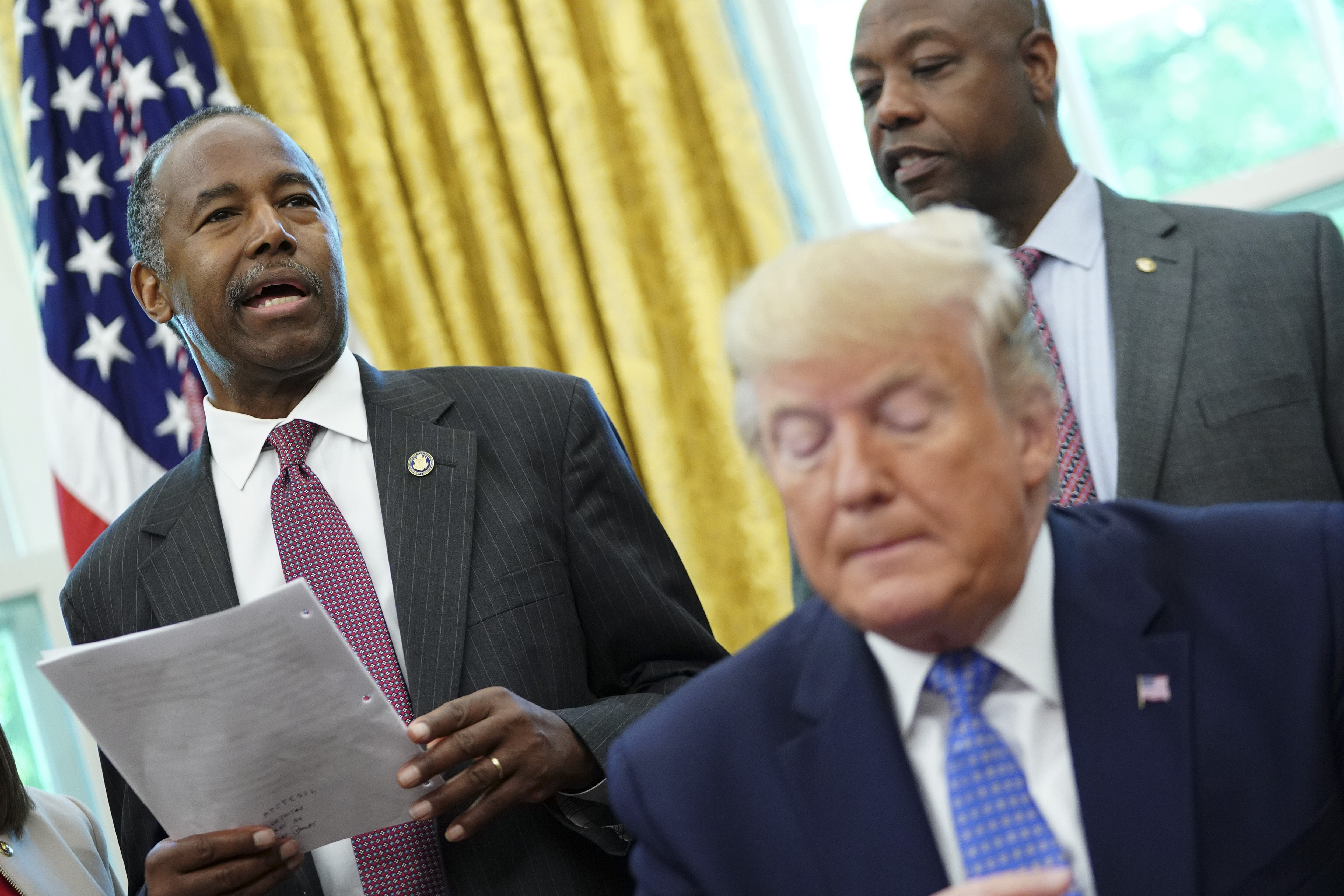 Ben Carson, US Secretary of Housing and Urban Development, speaks as US President Donald Trump signs an executive order to establish a White House council on affordable housing in the Oval Office of the White House in Washington, DC on June 25, 2019. (Photo by MANDEL NGAN / AFP) (Photo credit should read MANDEL NGAN/AFP/Getty Images)