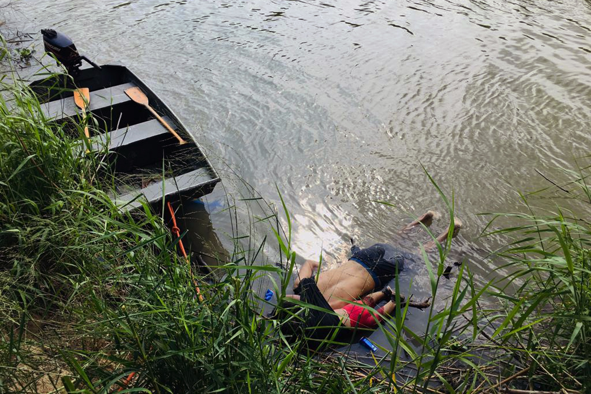 View of the bodies of Salvadoran migrant Oscar Martinez Ramirez and his daughter, who drowned while trying to cross the Rio Grande -on their way to the US- in Matamoros, state of Tamaulipas on June 24, 2019. (STR/AFP/Getty Images)
