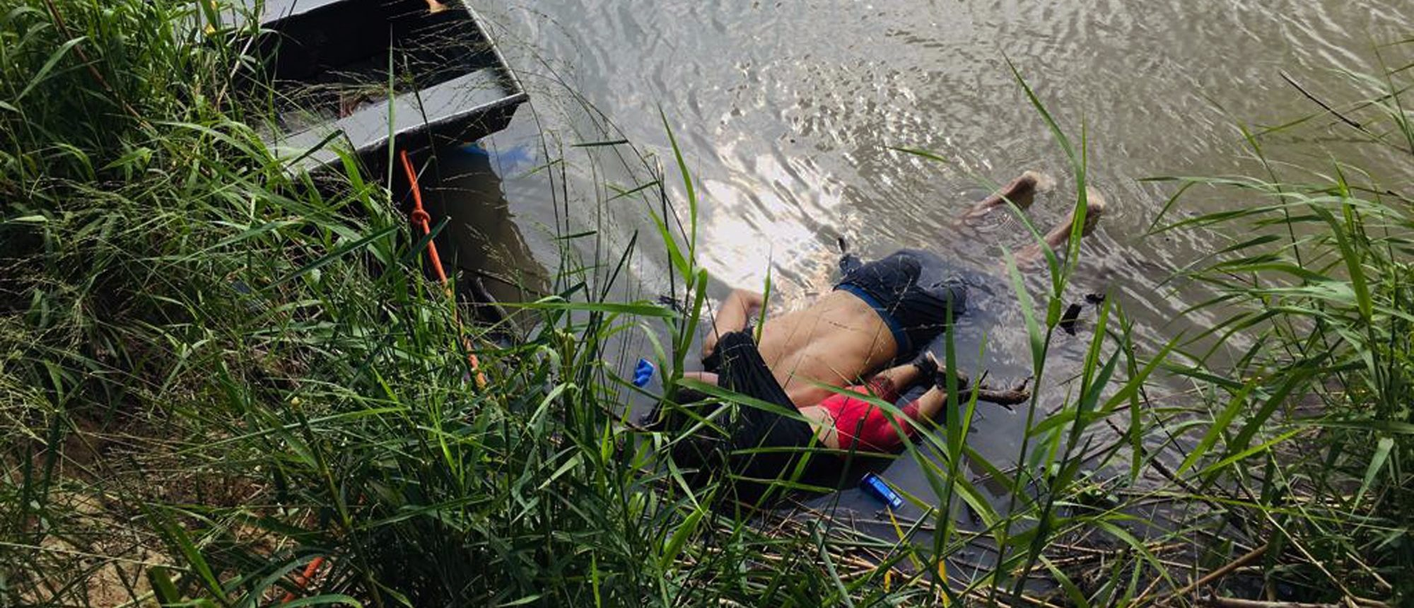 View of the bodies of Salvadoran migrant Oscar Martinez Ramirez and his daughter, who drowned while trying to cross the Rio Grande ... (Photo credit should read STR/AFP/Getty Images)