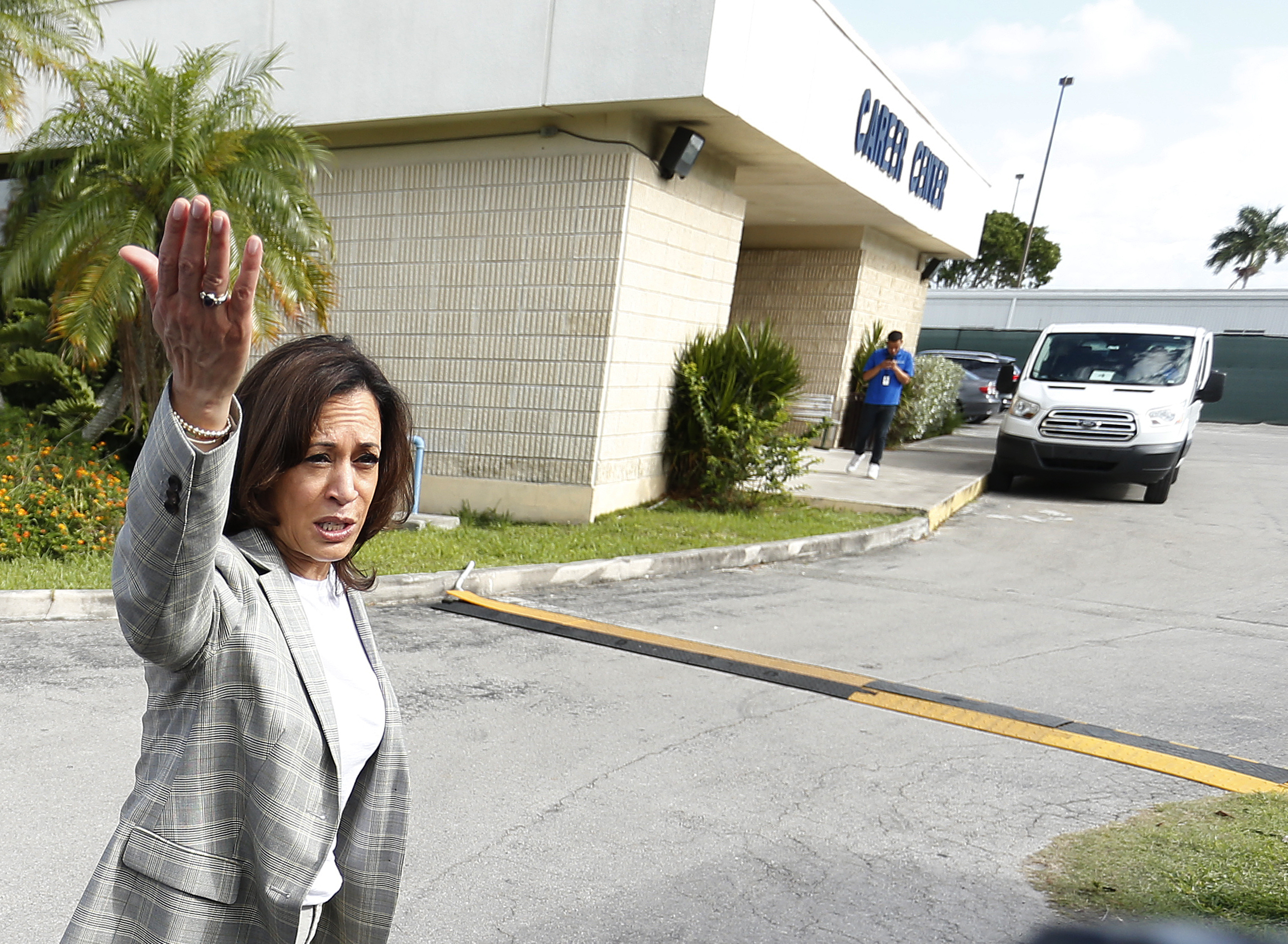 Democratic presidential hopeful Kamala Harris stops to address the media before entering the office where migrant children are being held in a detention center in Homestead, Florida on June 28, 2019. (Photo credit should read RHONA WISE/AFP/Getty Images)