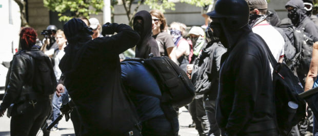 Unidentified Rose City Antifa members beat up Andy Ngo, a Portland-based journalist, on June 29, 2019 in Portland, Oregon. (Moriah Ratner/Getty Images)