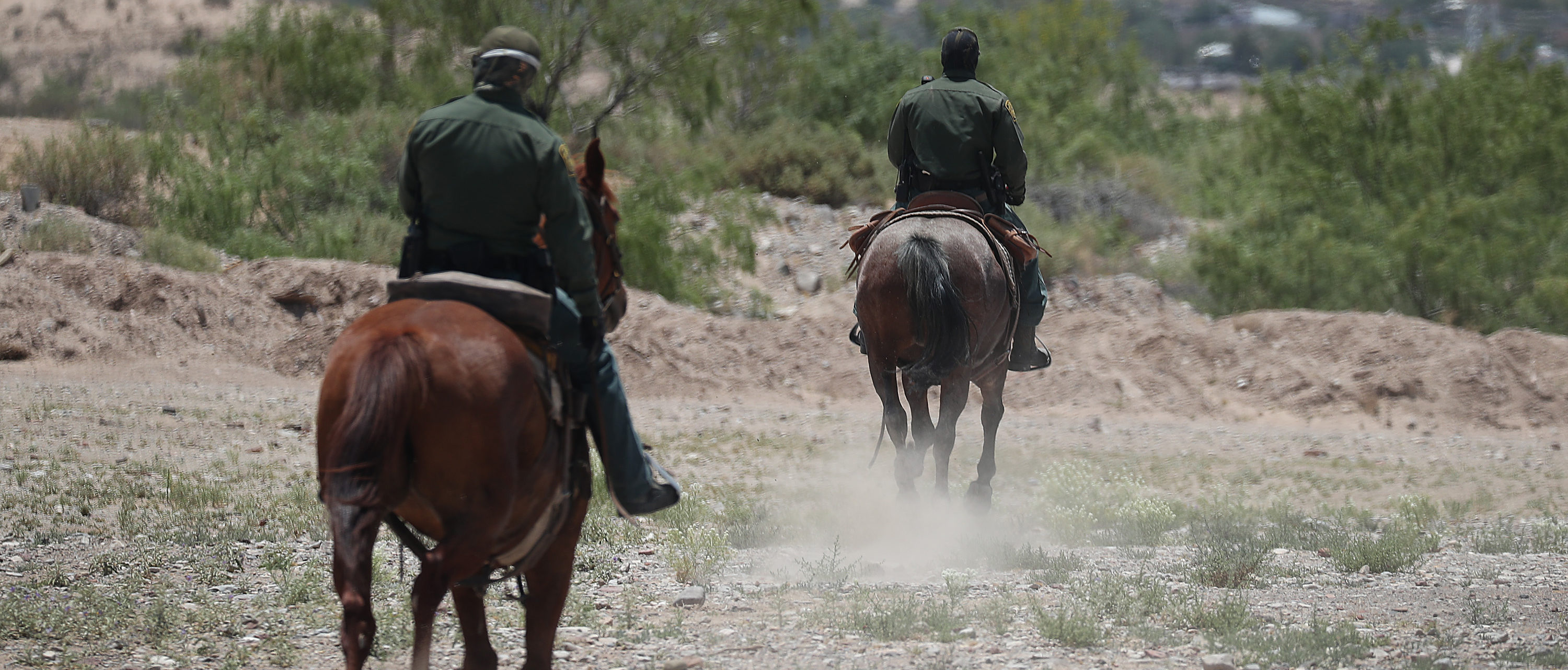 SUNLAND PARK, NM - JUNE 04: U.S. Border Patrol agents on horseback are seen as they patrol near the United States and Mexico border on June 04, 2019 in Sunland Park, New Mexico. In recent months, U.S. immigration officials have seen a surge in the number of asylum seekers arriving at the border. (Photo by Joe Raedle/Getty Images)