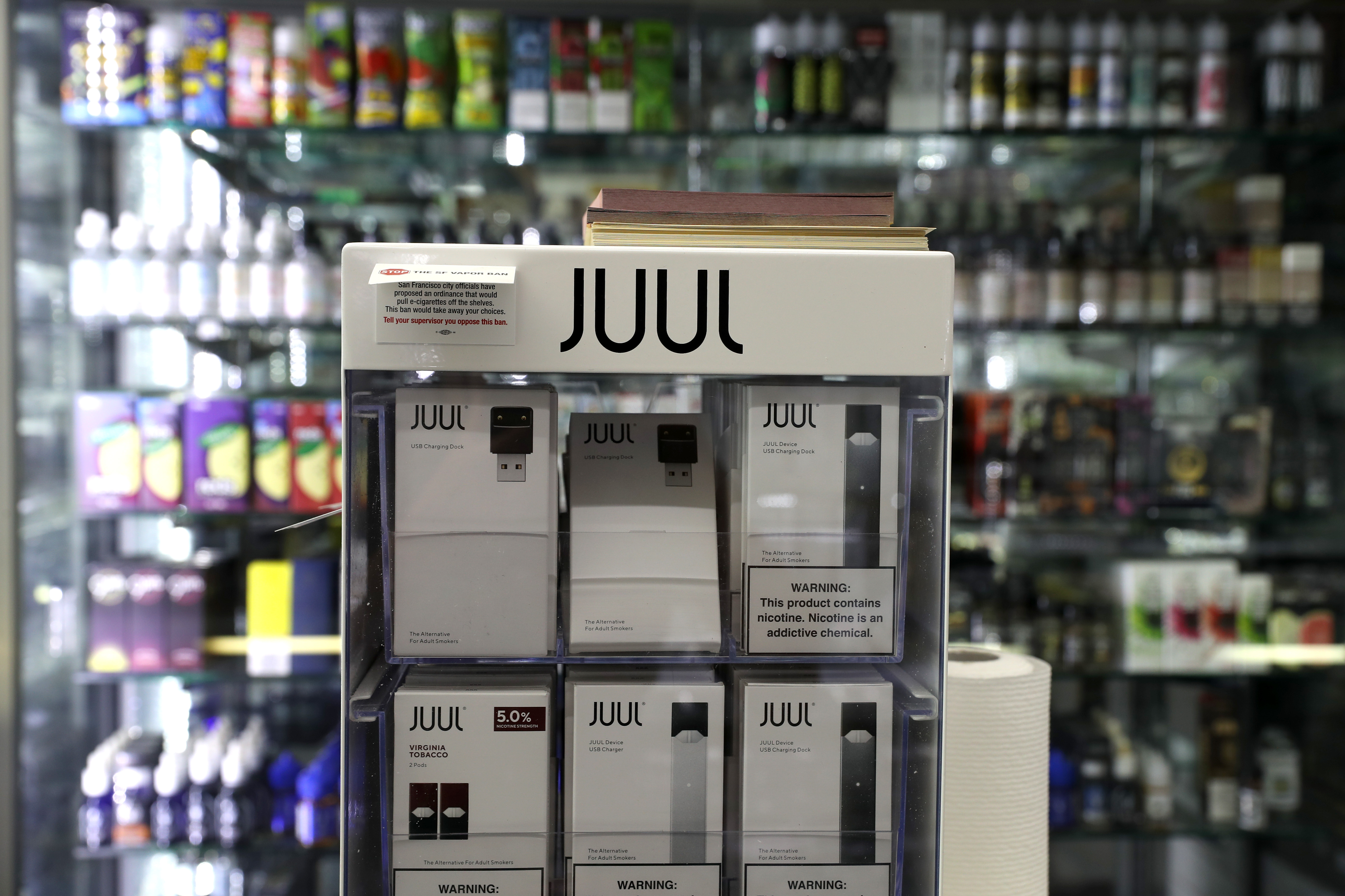 E-Cigarettes made by Juul are displayed at Smoke and Gift Shop on June 25, 2019 in San Francisco, California. (Photo by Justin Sullivan/Getty Images)