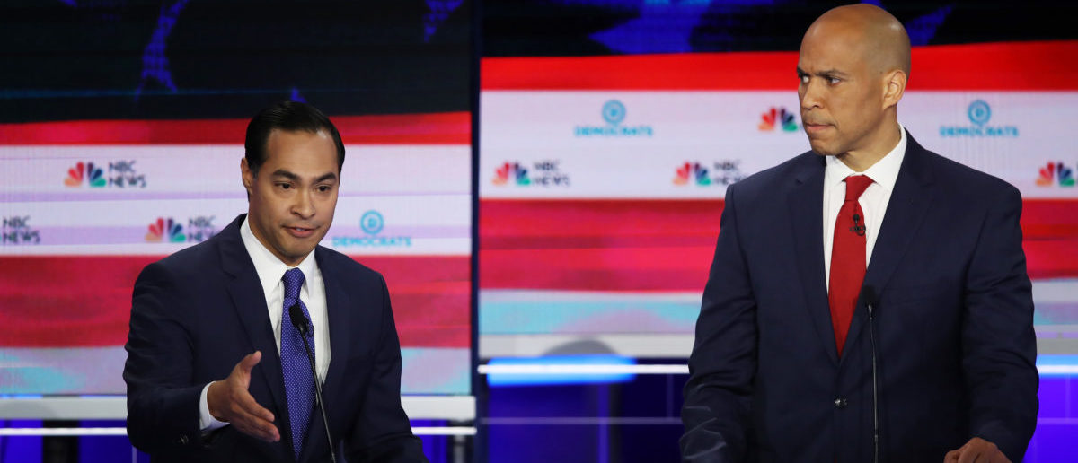 Former housing secretary Julian Castro and Sen. Cory Booker (D-NJ) take part in the first night of the Democratic presidential debate on June 26, 2019 in Miami, Florida. (Photo by Joe Raedle/Getty Images)