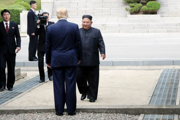 PANMUNJOM, SOUTH KOREA - JUNE 30: A handout photo provided by Dong-A Ilbo of North Korean leader Kim Jong Un and U.S. President Donald Trump inside the demilitarized zone (DMZ) separating the South and North Korea on June 30, 2019 in Panmunjom, South Korea. U.S. President Donald Trump and North Korean leader Kim Jong-un briefly met at the Korean demilitarized zone (DMZ) on Sunday, with an intention to revitalize stalled nuclear talks and demonstrate the friendship between both countries. The encounter was the third time Trump and Kim have gotten together in person as both leaders have said they are committed to the