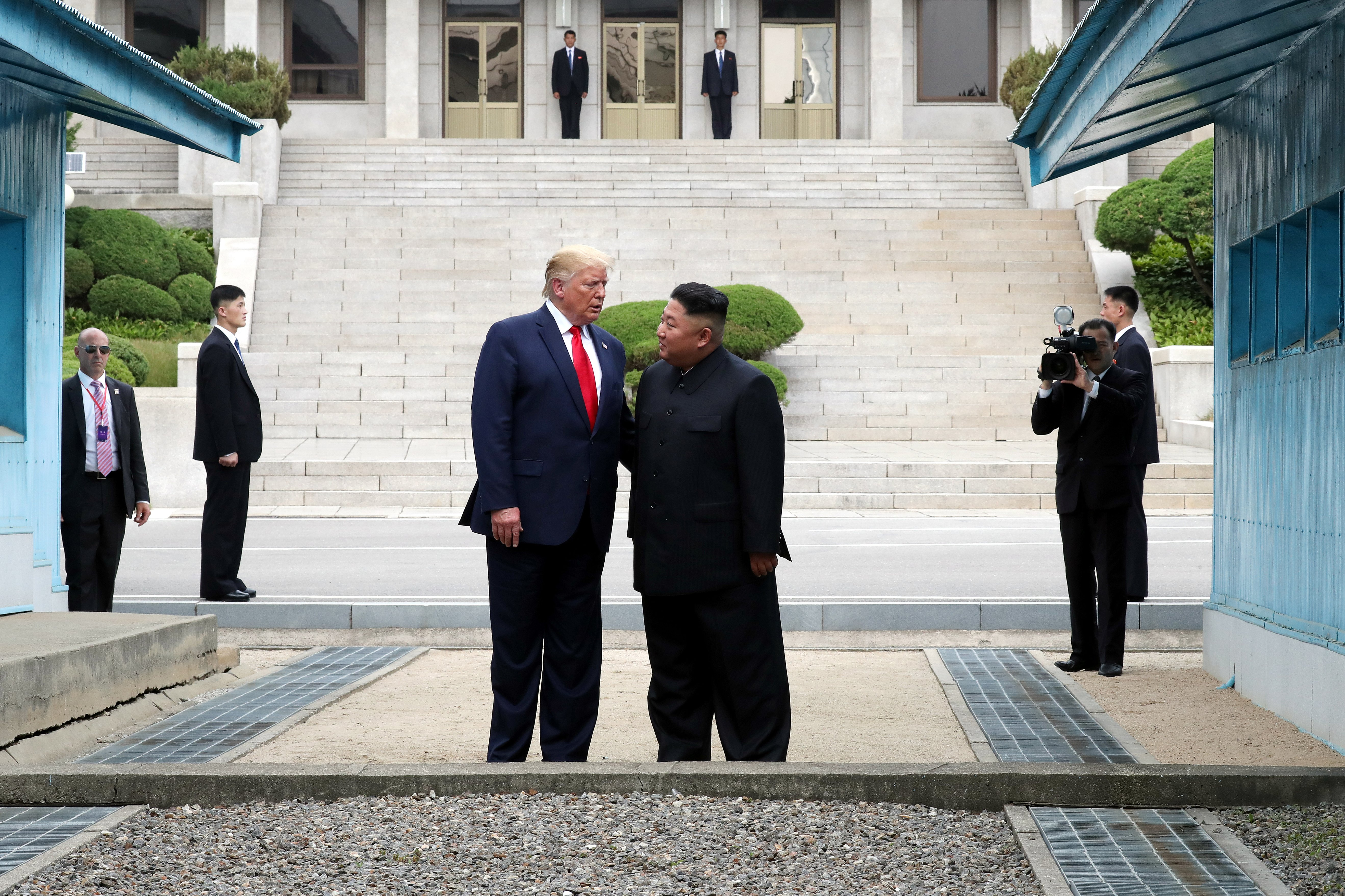 """A handout photo provided by Dong-A Ilbo of North Korean leader Kim Jong Un and U.S. President Donald Trump inside the demilitarized zone (DMZ) separating the South and North Korea on June 30, 2019 in Panmunjom, South Korea. U.S. President Donald Trump and North Korean leader Kim Jong-un briefly met at the Korean demilitarized zone (DMZ) on Sunday, with an intention to revitalize stalled nuclear talks and demonstrate the friendship between both countries. The encounter was the third time Trump and Kim have gotten together in person as both leaders have said they are committed to the """"complete denuclearization"""" of the Korean peninsula. (Photo by Handout/Dong-A Ilbo via Getty Images)"""