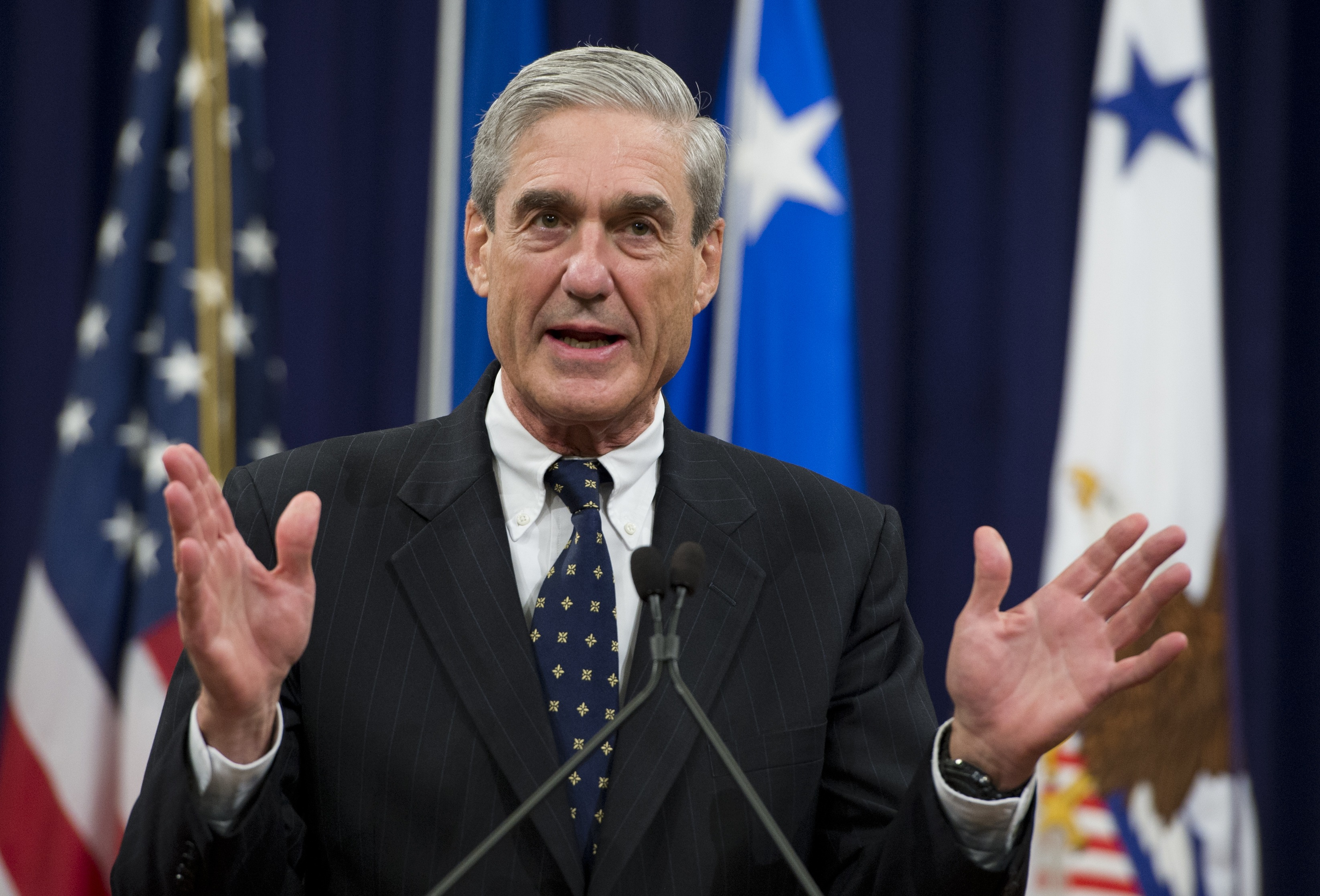 Federal Bureau of Investigation (FBI) Director Robert Mueller speaks during a farewell ceremony in Mueller's honor at the Department of Justice on August 1, 2013. Mueller is retiring from the FBI after 12-years as Director. (Photo: SAUL LOEB/AFP/Getty Images)