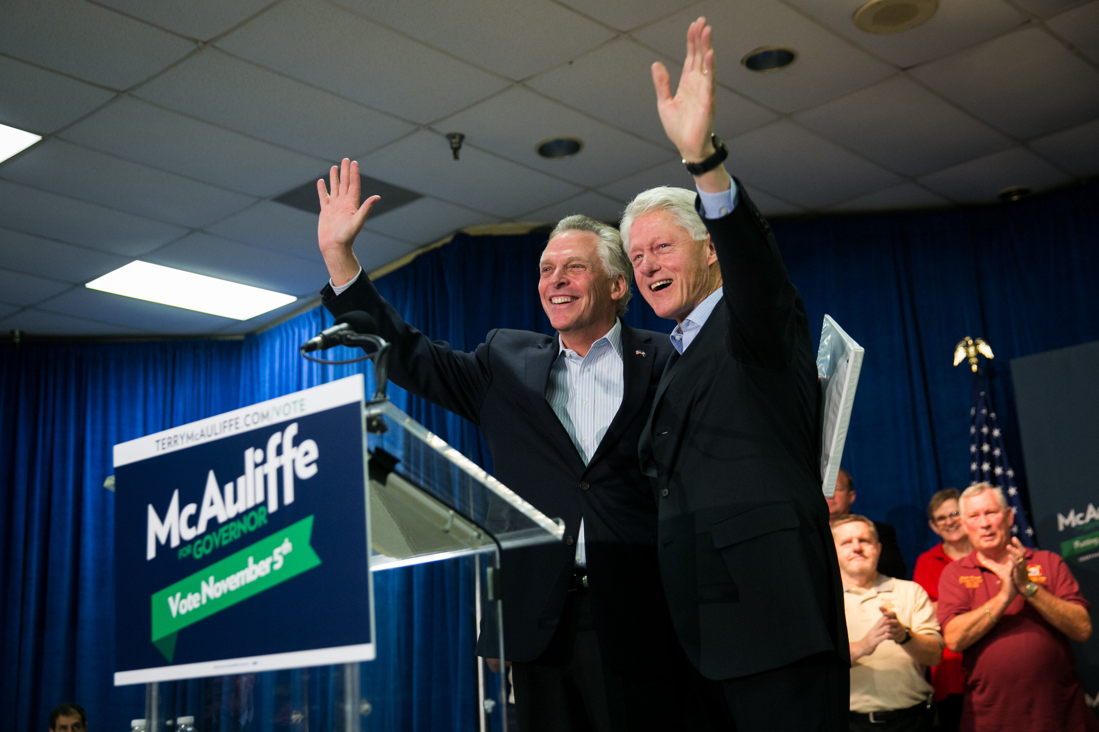 Former U.S. President Bill Clinton, R, and Virginia gubernatorial candidate Terry McAuliffe (D) wave to the crowd during a campaign event for McAuliffe at VFW Post 1503, October 27, 2013 in Dale City, Virginia. McAuliffe is in a closely contested race with Republican candidate Ken Cuccinelli. (Drew Angerer/Getty Images)