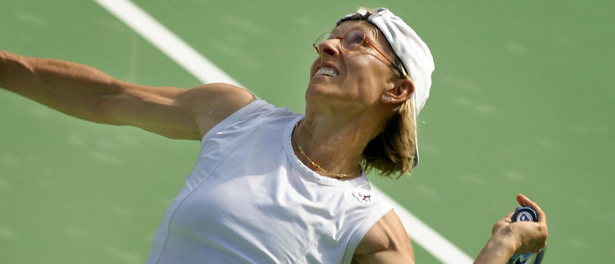 Tennis veteran Martina Navratilova of the United States serves during a women's doubles match at the Sydney International 12 January 2004. (DAVID HANCOCK/AFP/Getty Images)