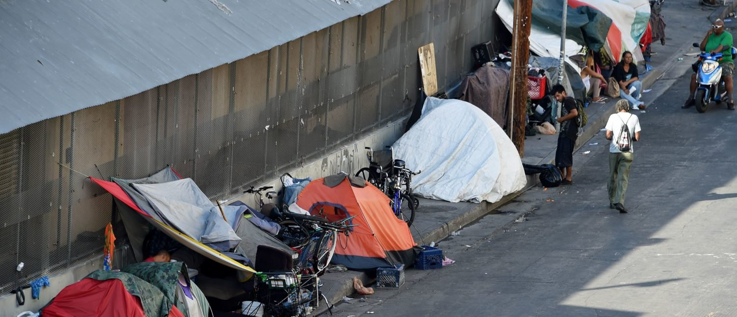 "Tens are placed along Skid Row is seen in Los Angles on September 23, 2015. Los Angeles elected officials this week declared a homelessness ""state of emergency"" and pledged $100 million in funding to tackle the crisis. (Photo credit should read ROBYN BECK/AFP/Getty Images)"