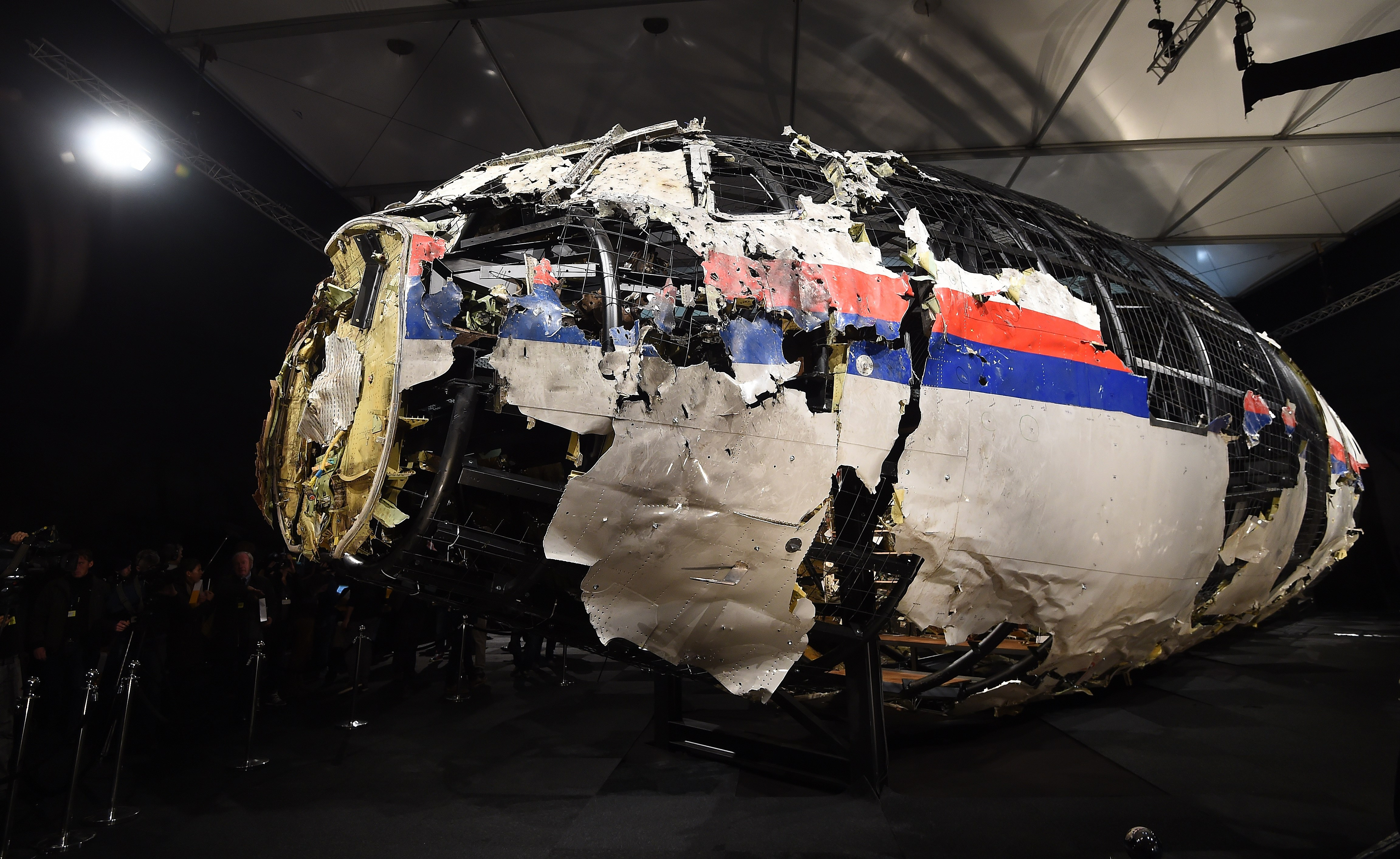 The wrecked cockipt of the Malaysia Airlines flight MH17 is presented to the press during a presentation of the final report on the cause of the its crash at the Gilze Rijen airbase October 13, 2015. (EMMANUEL DUNAND/AFP/Getty Images)