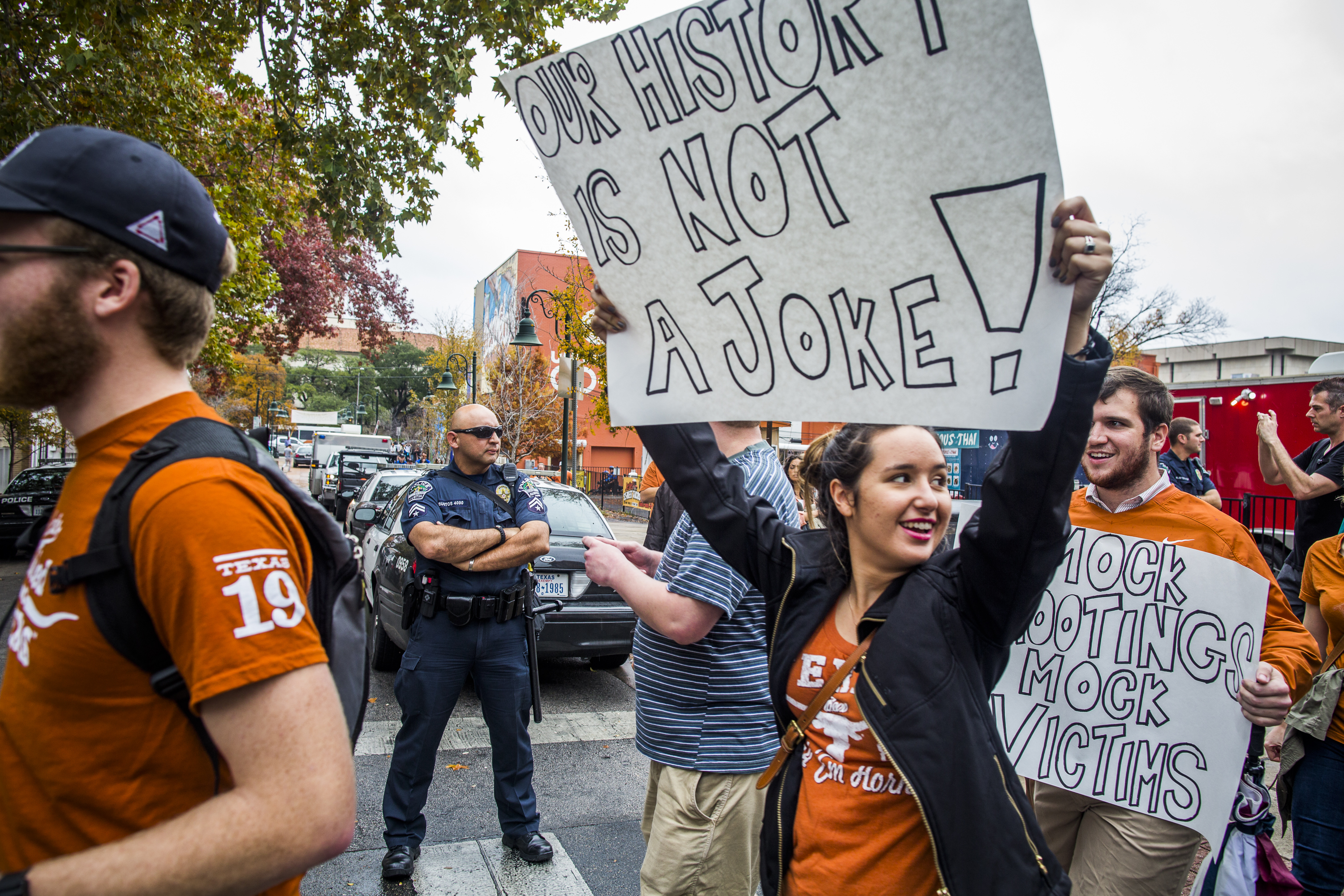 Pro-gun control protestors rally against an open carry demonstration close to The University of Texas campus December 12, 2015 in Austin, Texas. In addition to the event put on by DontComply.com, a gun activist organization, the group also held an open carry walk earlier in the day. (Photo by Drew Anthony Smith/Getty Images)
