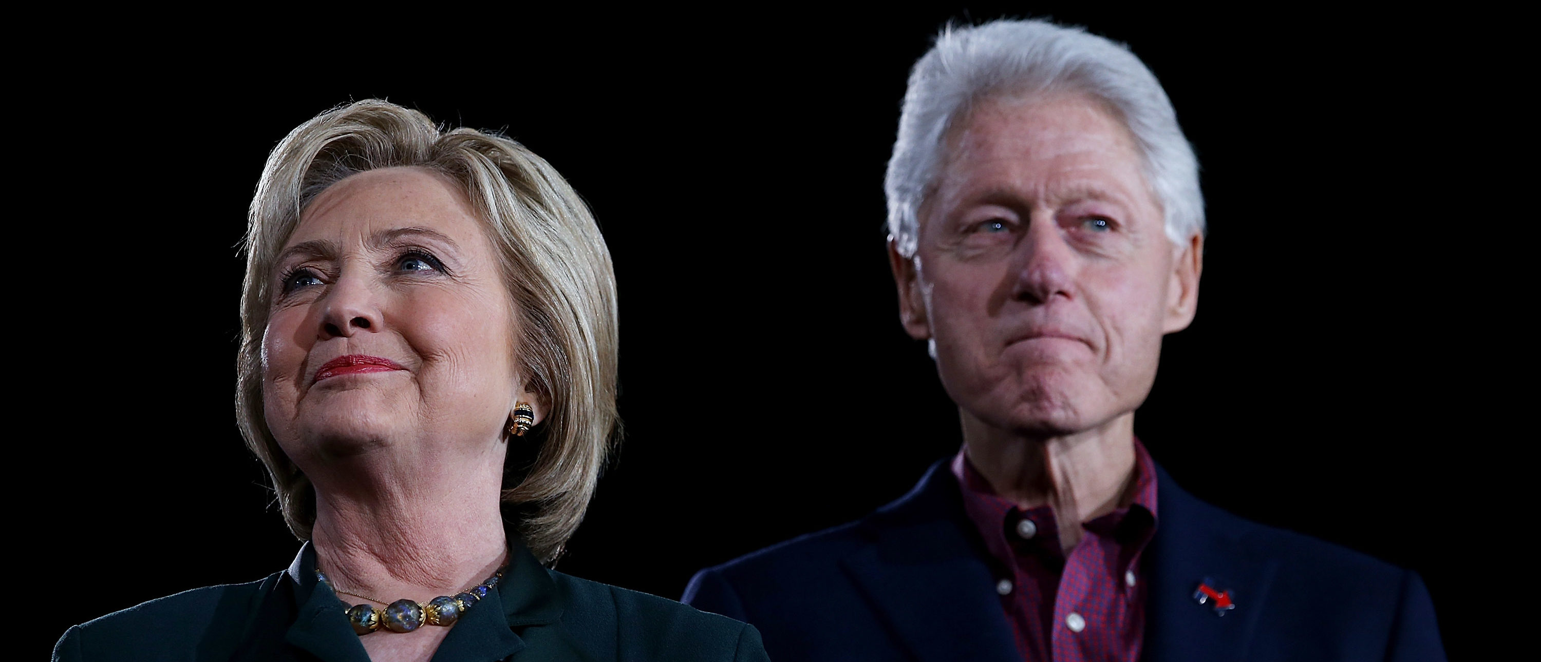 "Democratic presidential candidate former Secretary of State Hillary Clinton and her husband, former U.S. president Bill Clinton look on during a ""Get Out The Caucus"" at the Clark County Government Center on February 19, 2016 in Las Vegas, Nevada. With one day to go before the Democratic caucuses in Nevada, Hillary Clinton is campaigning in Las Vegas. (Photo by Justin Sullivan/Getty Images)"