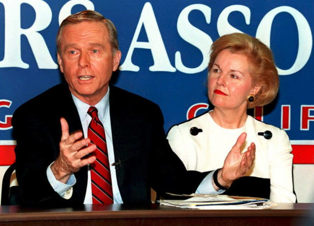 "LOS ANGELES, UNITED STATES: California governor Pete Wilson (R), with wife Gayle, announces plans to form a presidential exploratory committee at 23 March press conference in Los Angeles. The committee will ""lay the groundwork"" for Wilson's run for the Repubilcan nomination for President of the US in the 1996 election. (R). (JEFF HAYNES/AFP/Getty Images)"