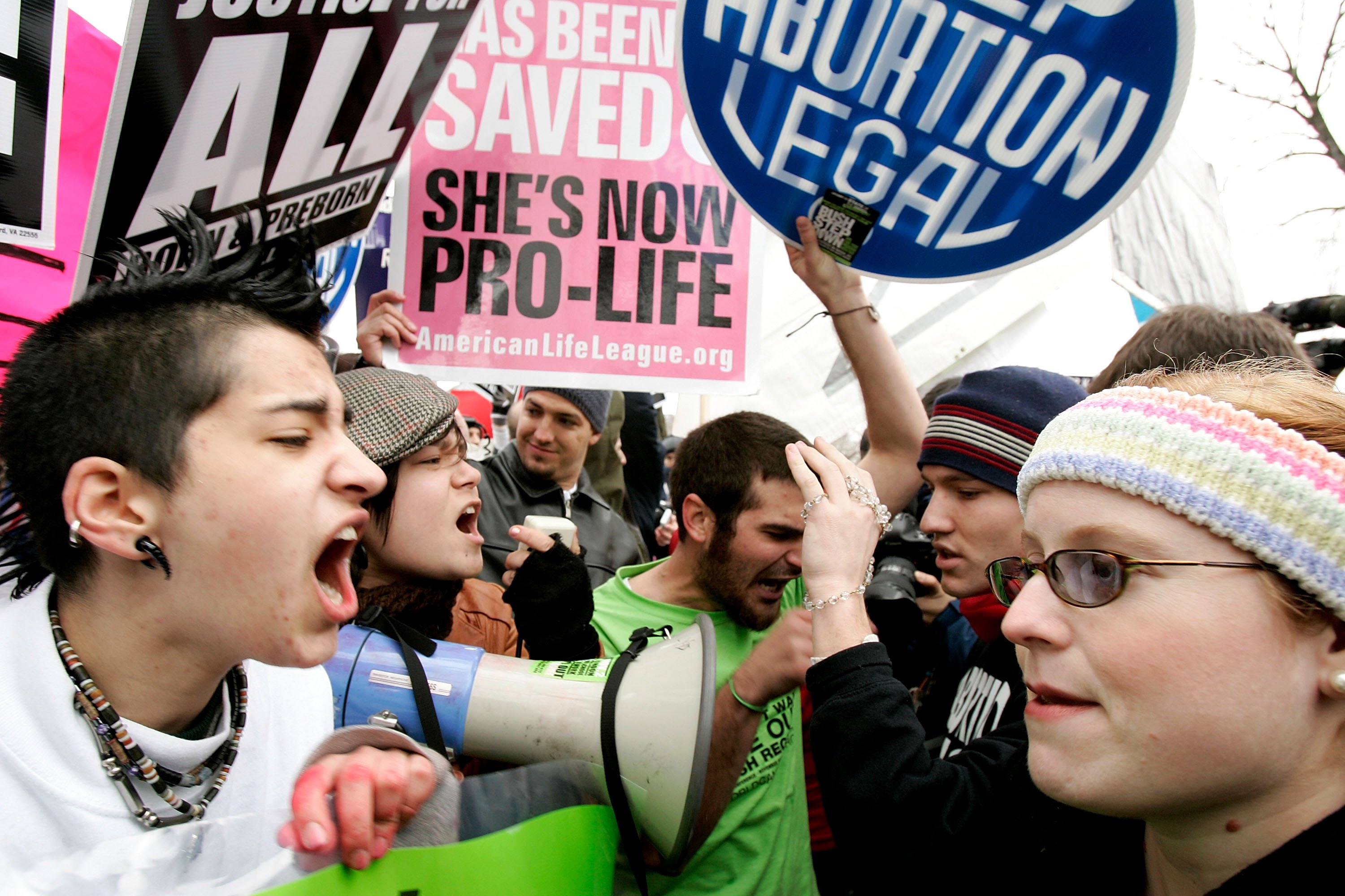 WASHINGTON - JANUARY 23: Pro-choice activists (L) argue with Pro-life activists (R) on abortion issues in front of the U.S. Supreme Court January 23, 2006 in Washington, DC. Thousands of people took part in the annual ?March for Life? event to mark the 33rd anniversary of the Roe v. Wade ruling that legalized abortion. (Photo by Alex Wong/Getty Images)