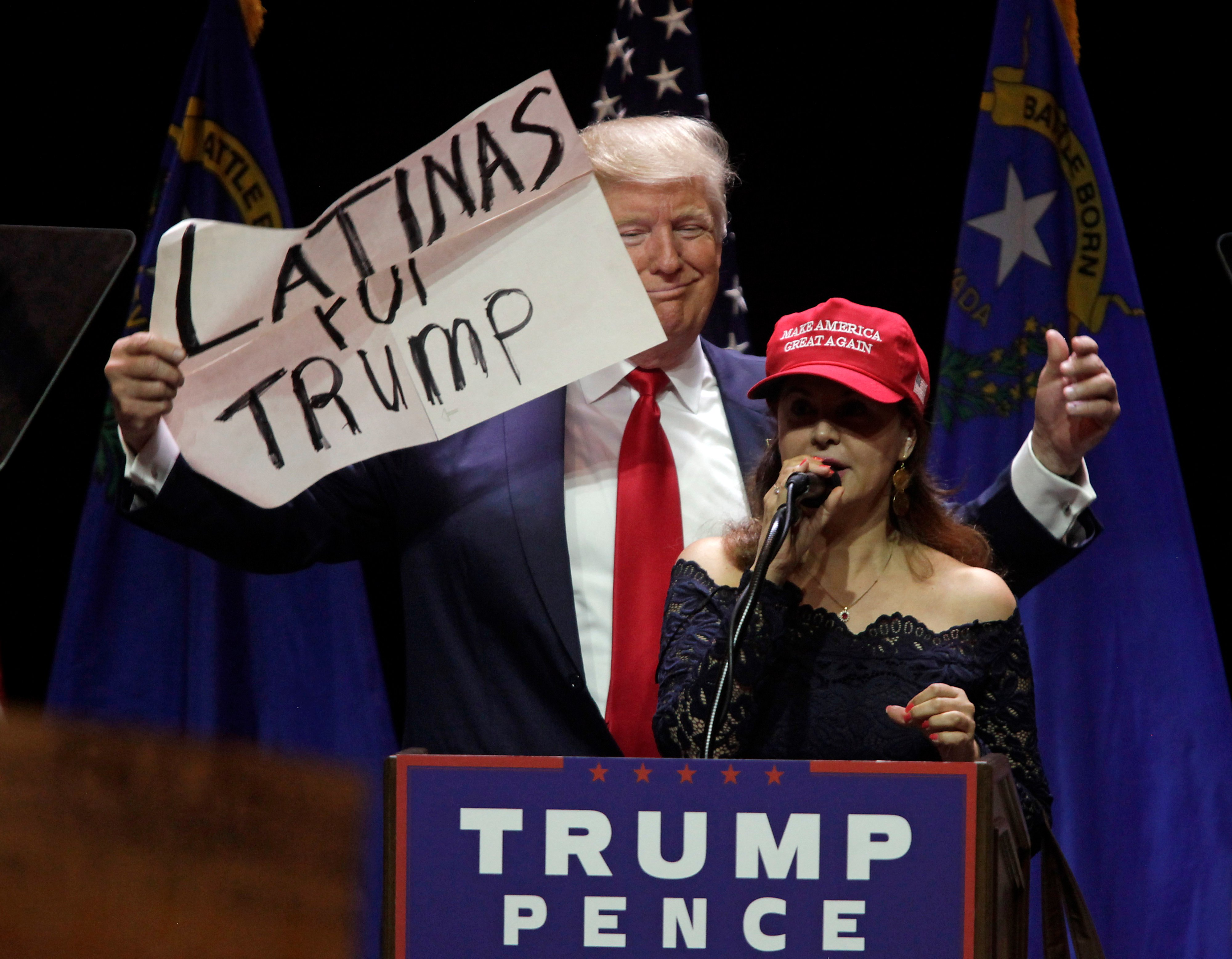 A Latino supporter speaks on stage with Republican presidential candidate Donald Trump during a campaign rally at the Venetian Hotel on October 30, 2016 in Las Vegas, Nevada. (JOHN GURZINSKI/AFP/Getty Images)