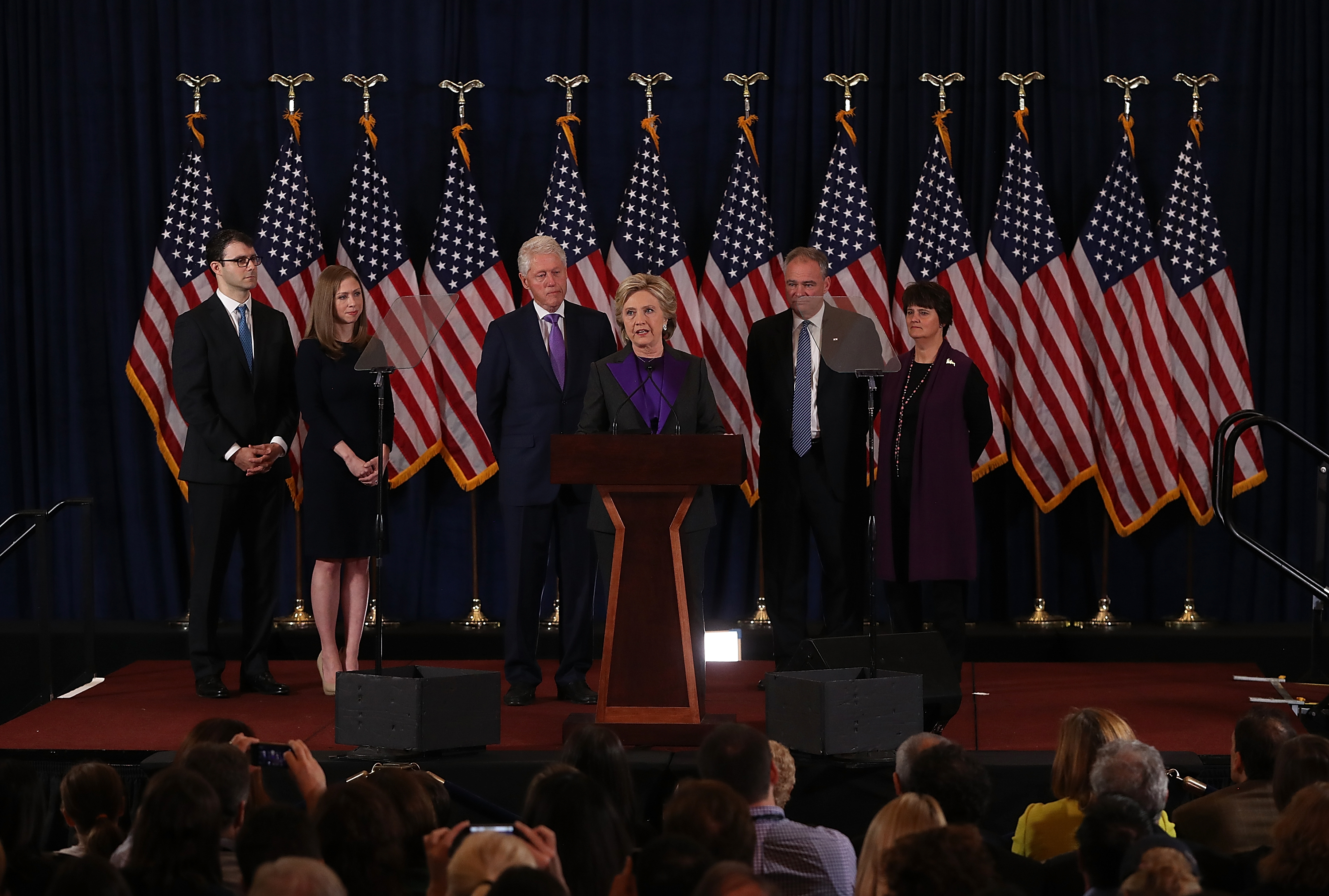 Former Secretary of State Hillary Clinton concedes the presidential election as Marc Mezvinsky, Chelsea Clinton, Bill Clinton, Tim Kaine and Anne Holton listen at the New Yorker Hotel on November 9, 2016 in New York City. (Photo by Justin Sullivan/Getty Images)