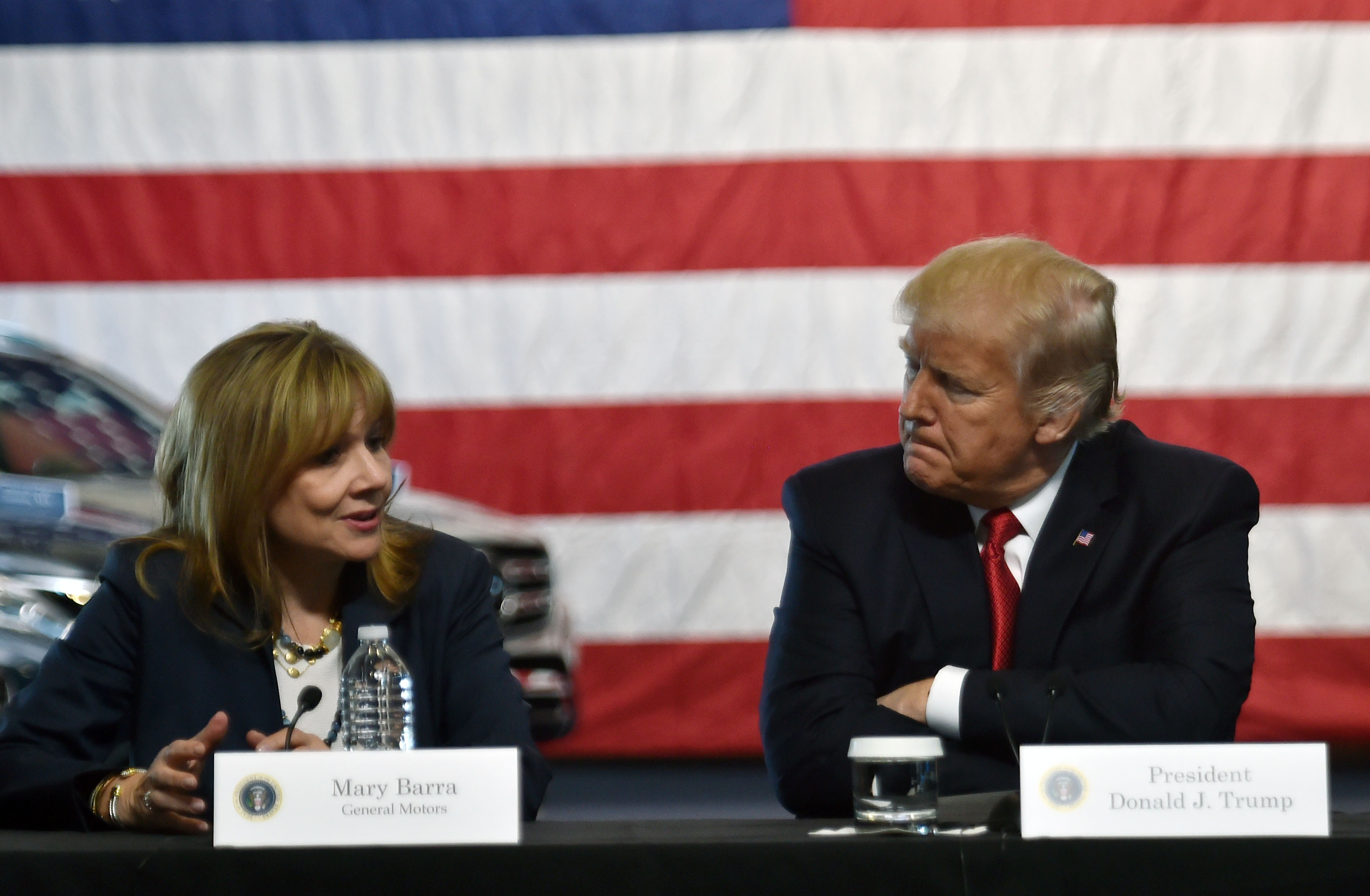 US President Donald Trump speaks at American Center for Mobility in Ypsilanti, Michigan with General Motors CEO Mary Barra on March 15, 2017. / AFP PHOTO / Nicholas Kamm (Photo credit should read NICHOLAS KAMM/AFP/Getty Images)