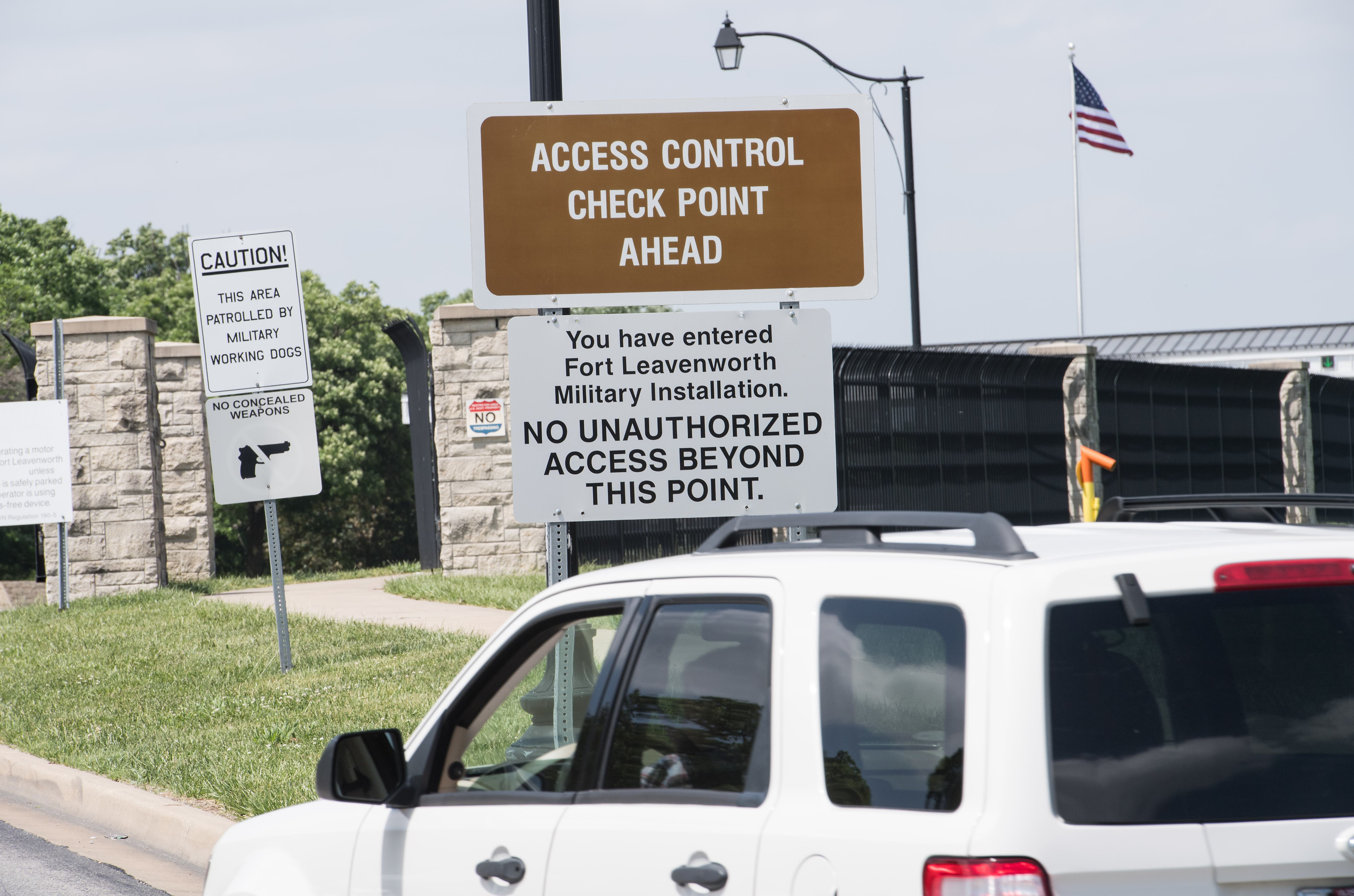 A car drives past a sign at the entrance to US Army facility Fort Leavenworth in Leavenworth, Kansas, on May 16, 2017. After seven years behind bars, US Army Private Chelsea Manning will walk out of the security gates of the Fort Leavenworth military prison on May 17, finally able to complete her transition as a free, openly transgender woman. (Photo credit should read NICHOLAS KAMM/AFP/Getty Images)