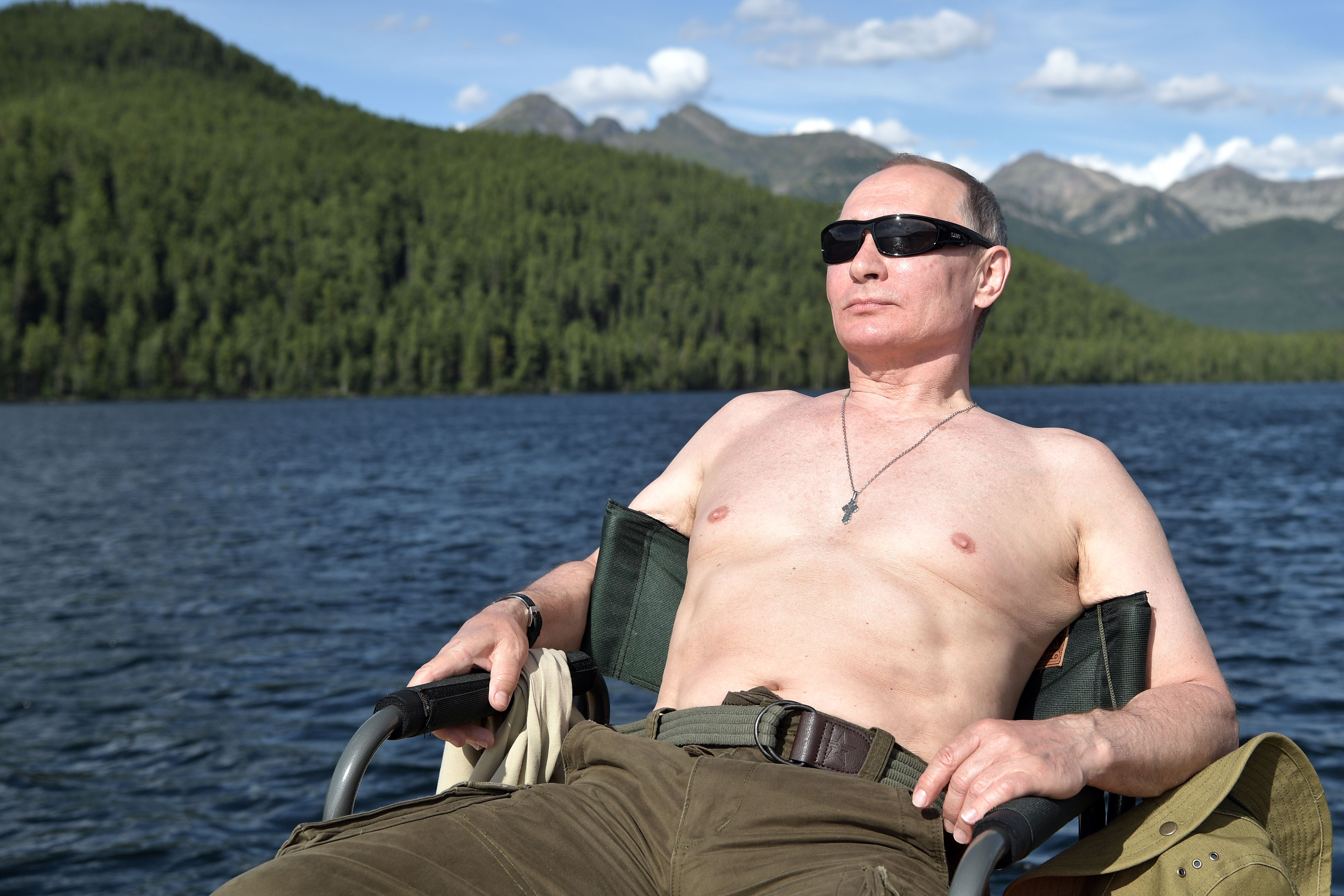 Russian President Vladimir Putin sunbathes during his vacation in the remote Tuva region in Siberia, August 1 - 3, 2017. (Alexey Nikolsky/AFP/Getty Images)