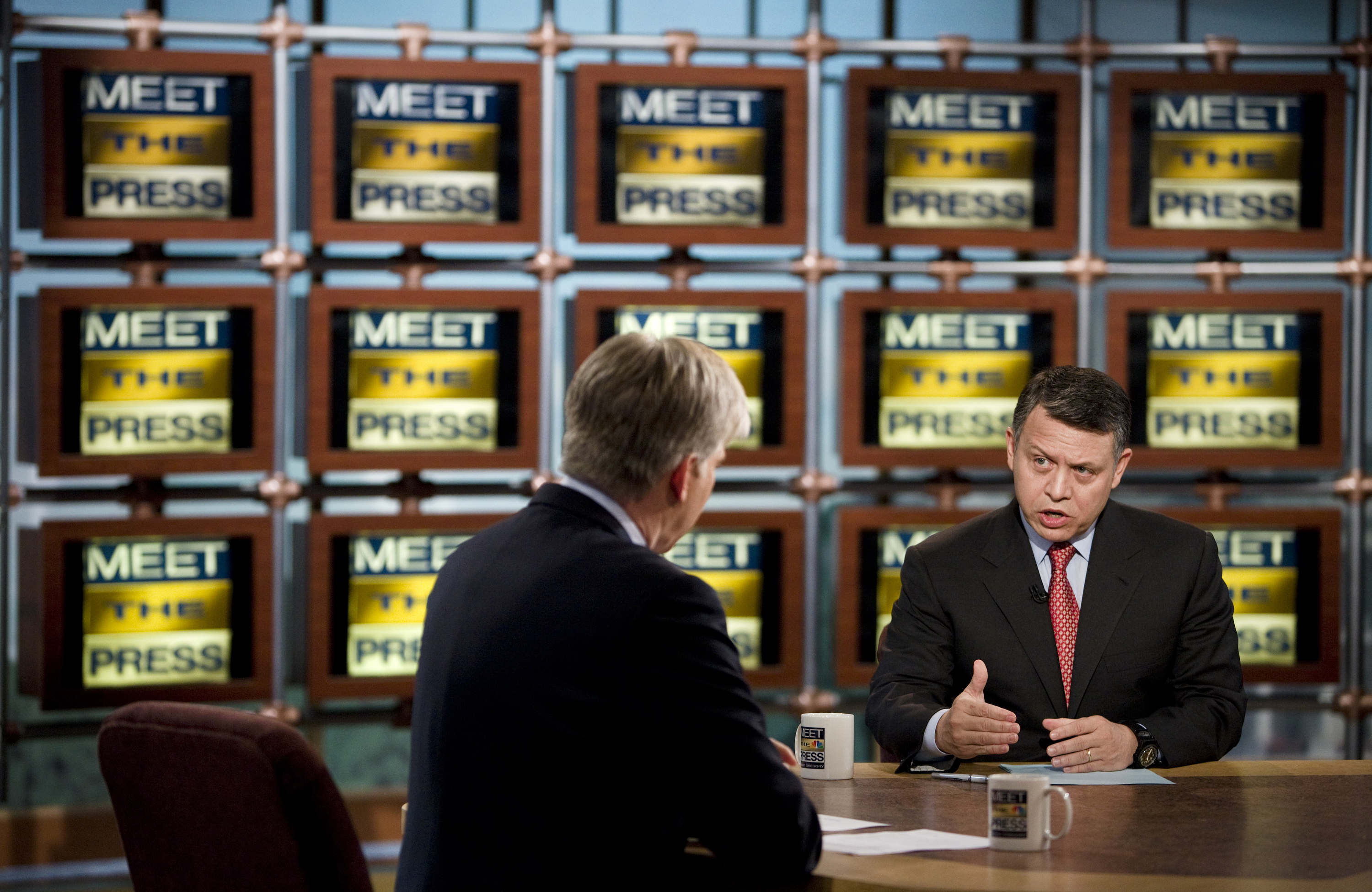 "David Gregory (L) listens to King Abdullah II of Jordan (R) speak during a pre-taping of ""Meet the Press"" at NBC April 24, 2009 in Washington, DC. King Abdullah II of Jordan spoke about his recent trip to the United States and the Middle East peace process. (Photo by Brendan Smialowski/Getty Images for Meet the Press)"