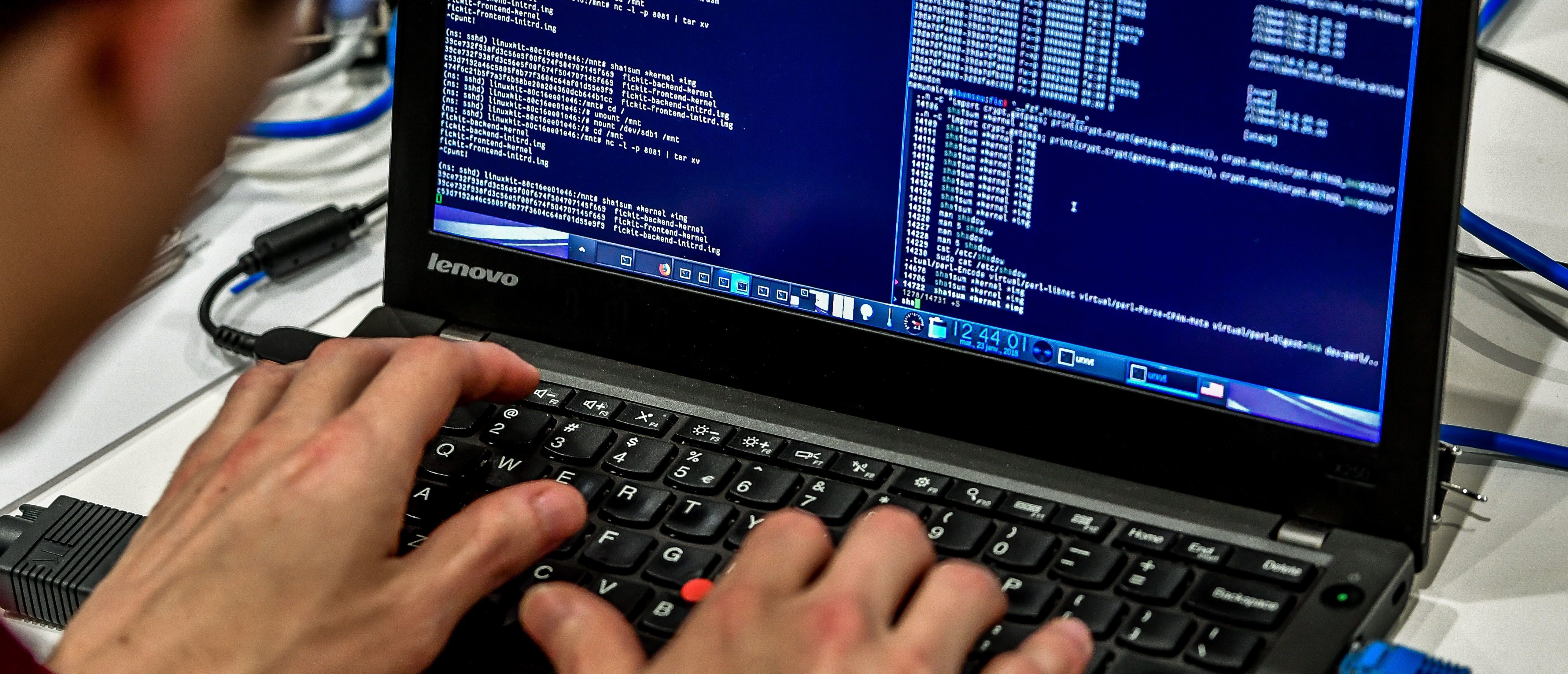 A person works at a computer during the 10th International Cybersecurity Forum/ PHILIPPE HUGUEN/AFP/Getty Images