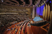 SALT LAKE CITY - OCTOBER 3: The Mormon Tabernacle Choir and the congregation sing a rest hymn in the Conference Center during the 179th Semi-Annual General Conference of the church October 3, 2009 in Salt Lake City, Utah. Several thousand Mormons are gathering for two days to hear guidance from church leaders. (Photo by George Frey/Getty Images)