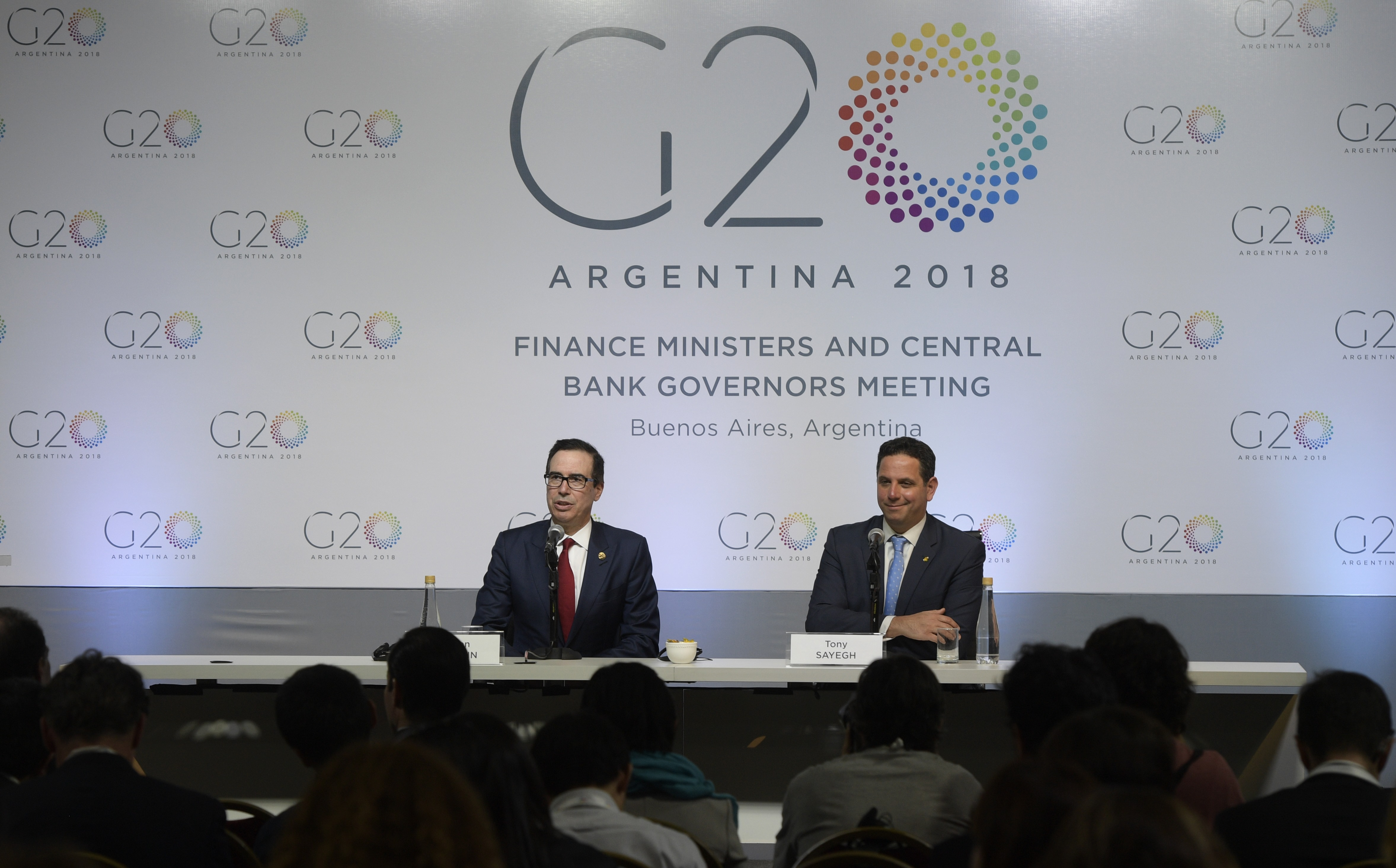US Treasury Secretary Steven Mnuchin (L) delivers a speech next to Assistant Secretary for Public Affairs for the U.S. Department of the Treasury, Tony Sayegh, during the G20 meeting of Finance Ministers and Central Bank Governors, in Buenos Aires, on March 20, 2018.